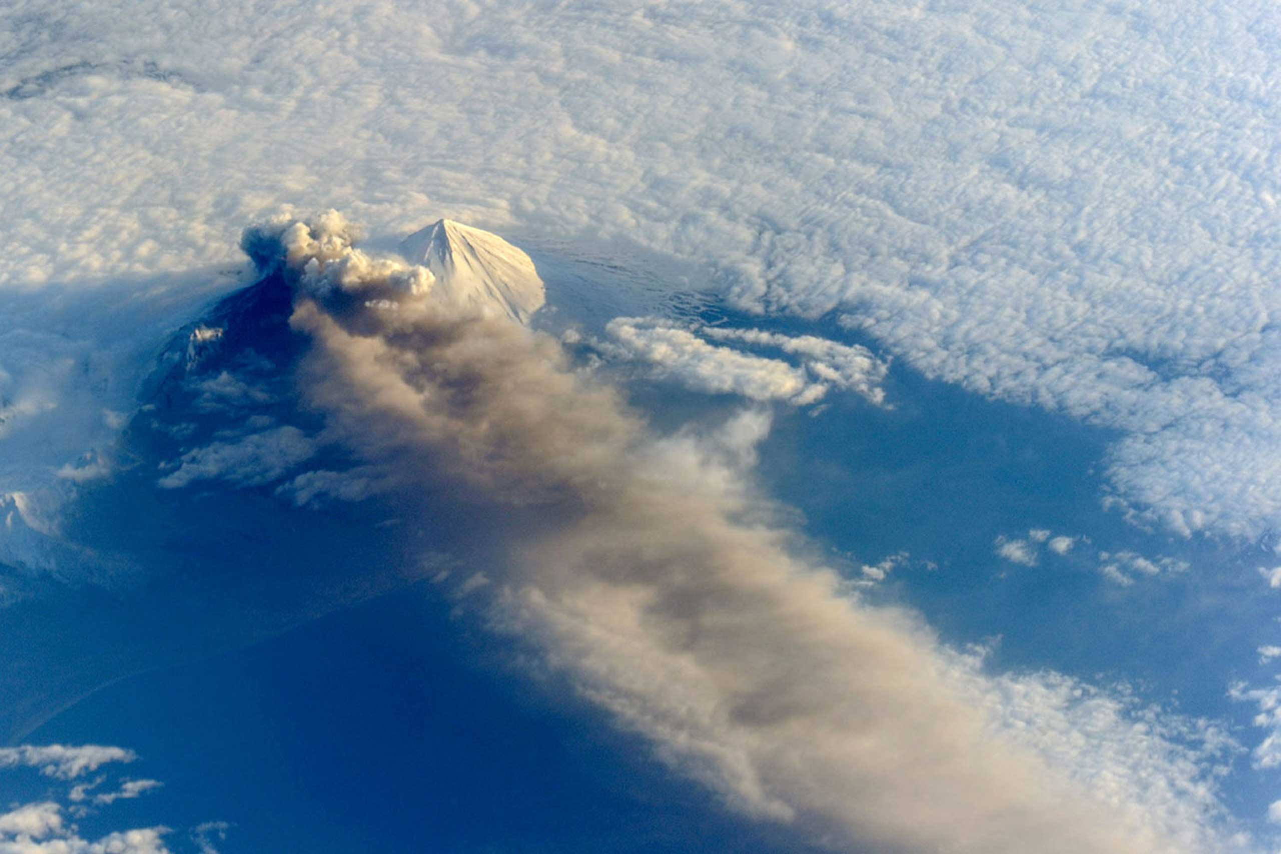 Astronauts aboard the International Space Station photographed the Pavlof Volcano on May 18, 2013. The volcano jetted lava into the air and spewed an ash cloud 20,000 feet high.