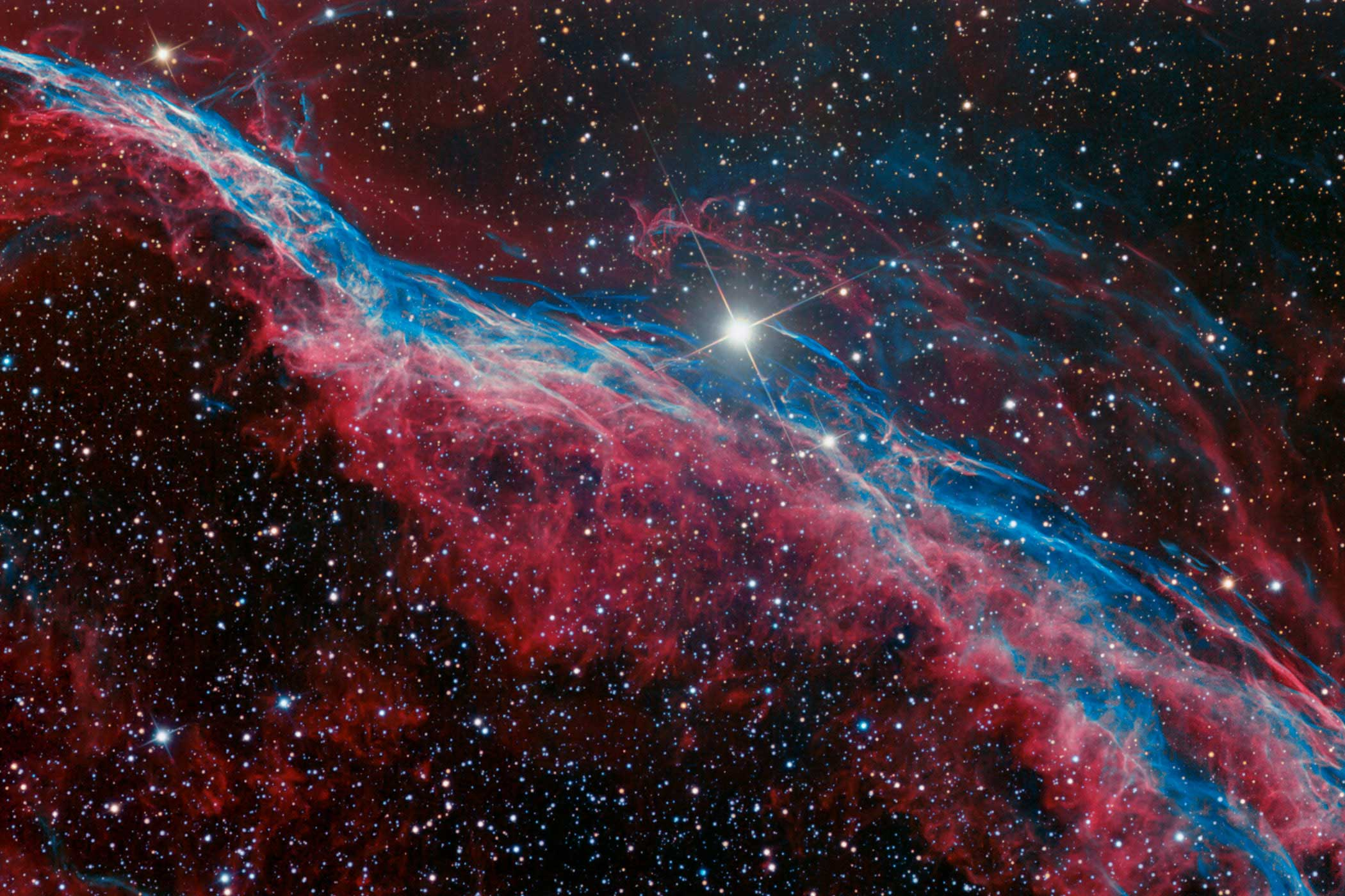 Part of the Veil Nebula, the Witch's Broom is the glowing debris from a supernova explosion. It's what's left over after the violent death of a massive star. Although the supernova occurred several thousand years ago, the gaseous debris is still expanding outwards, producing this vast cloud-like structure.