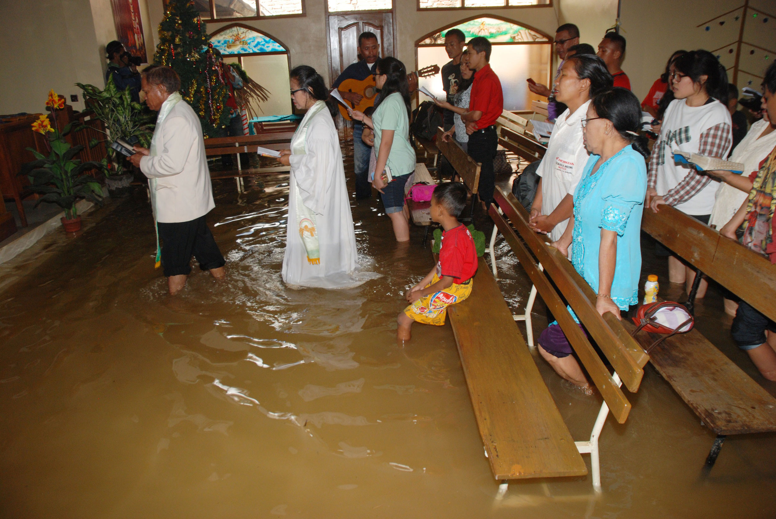 Christians attend the mass service at a flooded church in Bandung, in western Java island, on Dec. 25, 2014.