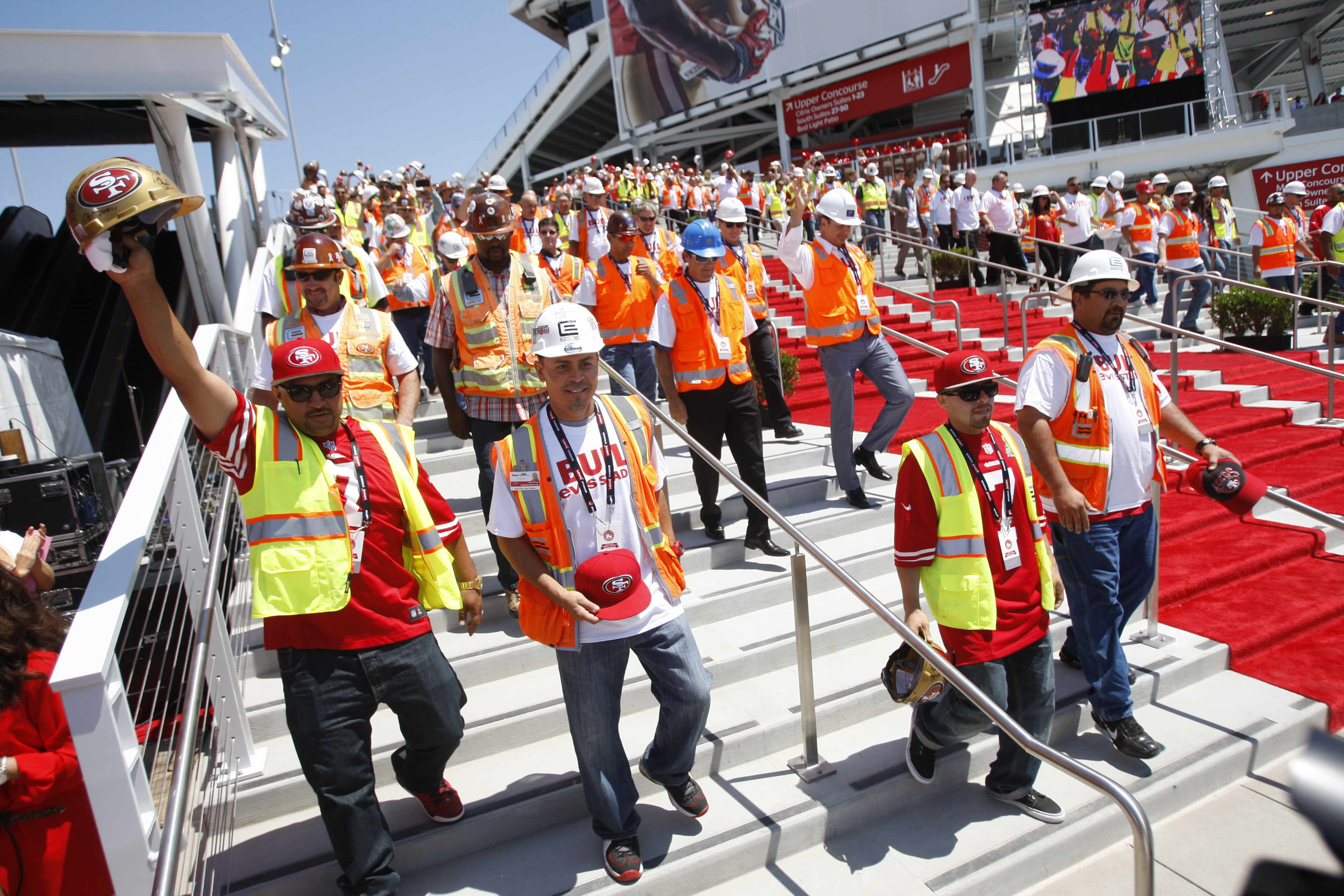 Workers head down the stairs during the Ribbon Cutting Ceremony for Levi Stadium on July 17, 2014 in Santa Clara, California.