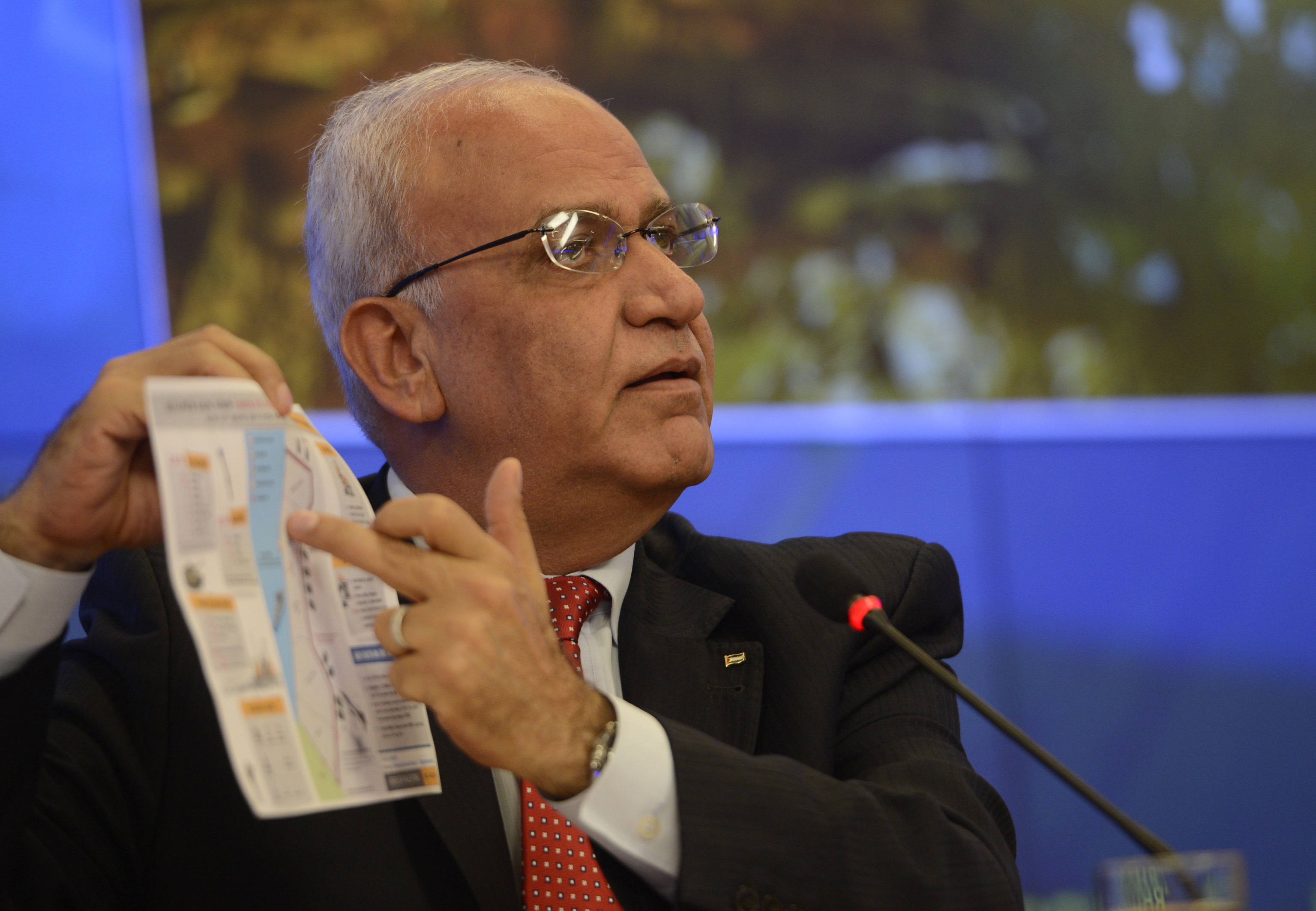 Chief Palestinian negotiator Saeb Erekat speaks to media about the peace negotiations between Palestine and Israel after a meeting with Russian Foreign Minister Sergei Lavrov (not seen) in Moscow on Aug. 19, 2014