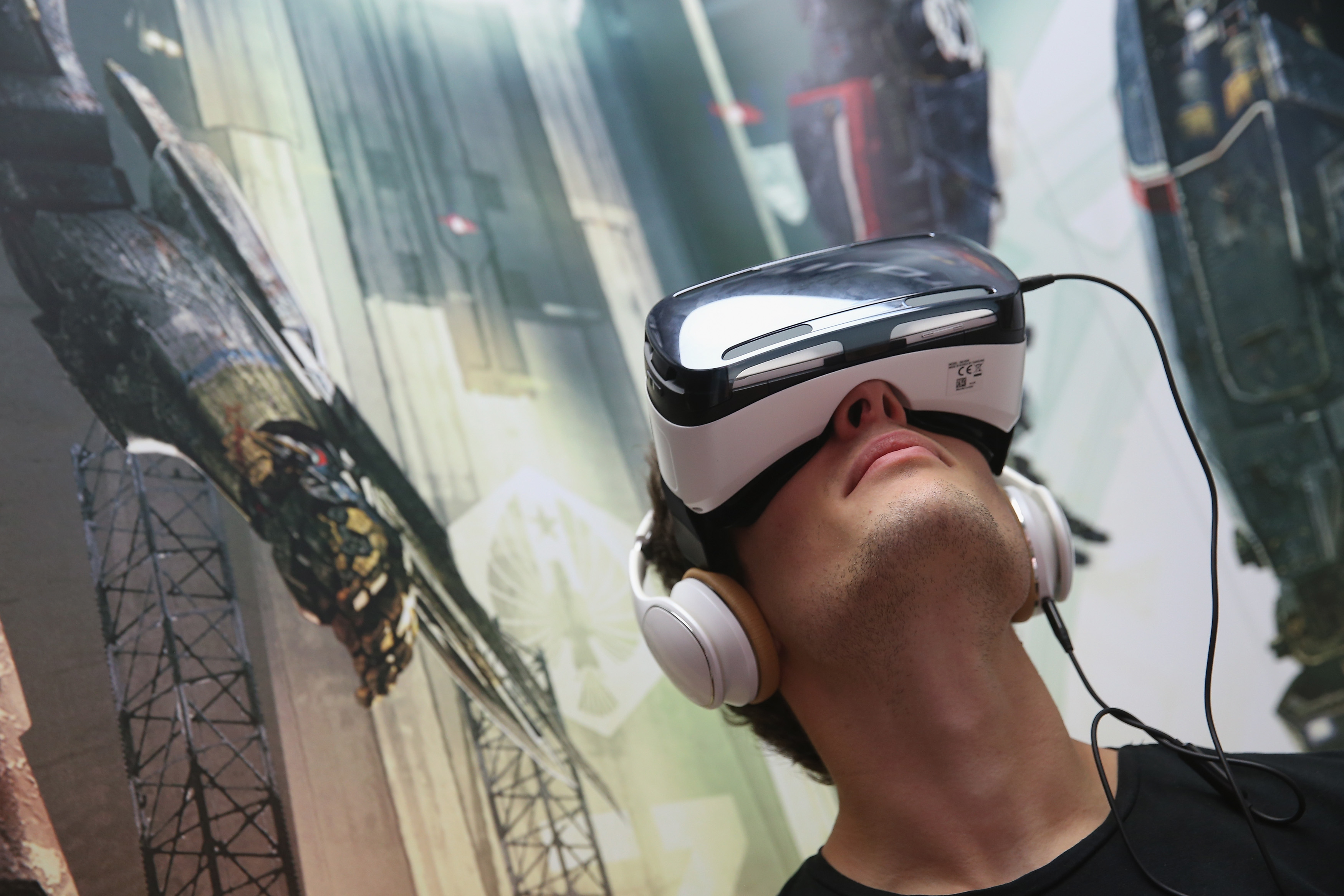 A visitor tries out Gear VR virtual reality goggles amd headphones at the Samsung stand at the 2014 IFA home electronics and appliances trade fair on September 5, 2014 in Berlin.