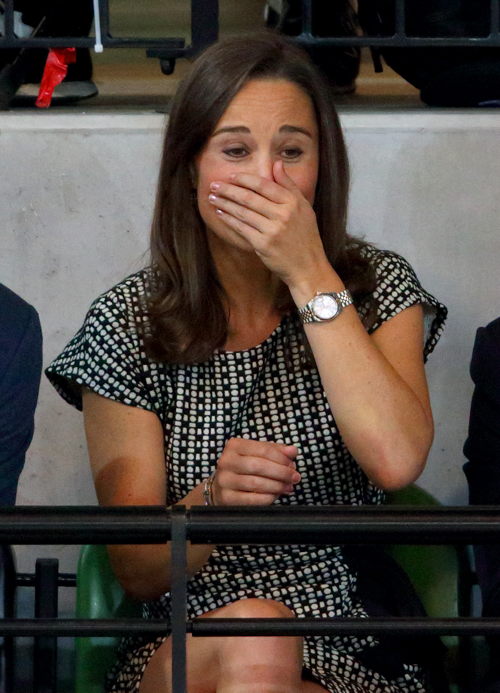 Pippa Middleton watches Prince Harry and Zara Phillips compete in a Wheelchair Rugby exhibition match in the Copper Box Arena during the Invictus Games