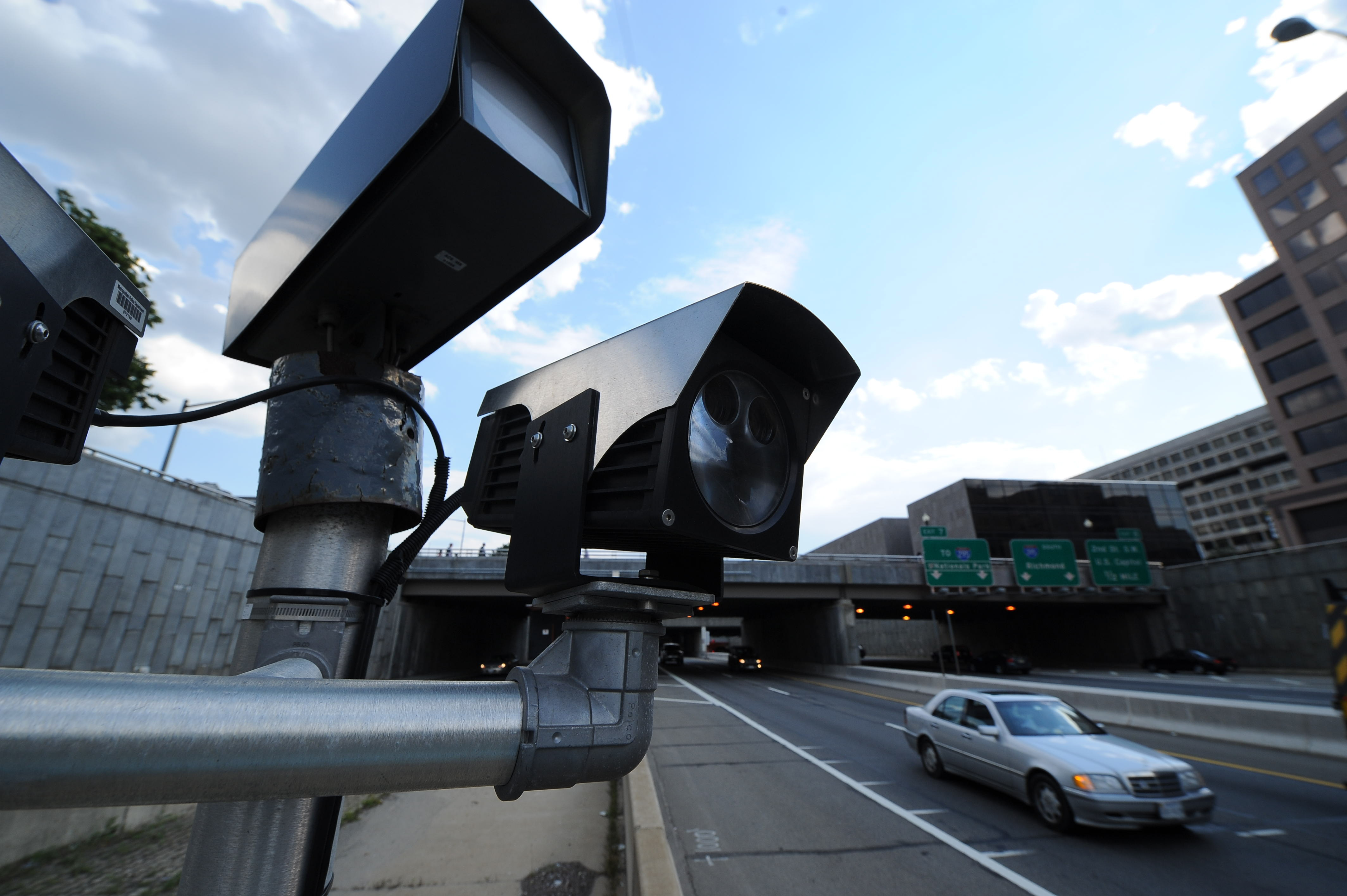 Speed cameras capture motorists on I-395 near 2nd Street NW in Washington, DC on June 7, 2012.