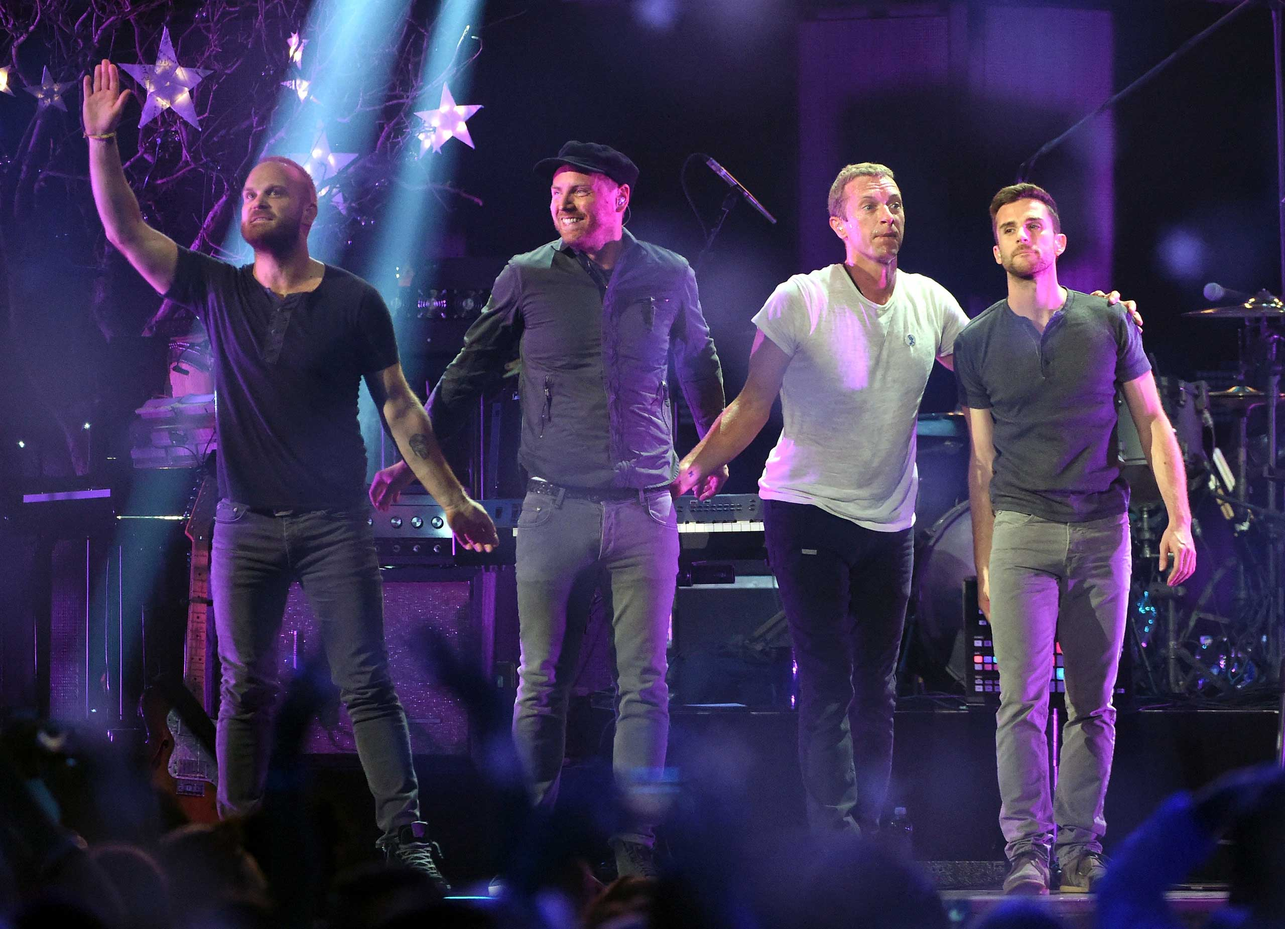 From left to right, drummer Will Champion, guitarist Jonny Buckland, frontman Chris Martin and bassist Guy Berryman of Coldplay perform during the 2014 iHeartRadio Music Festival on Sept. 19, 2014 in Las Vegas.