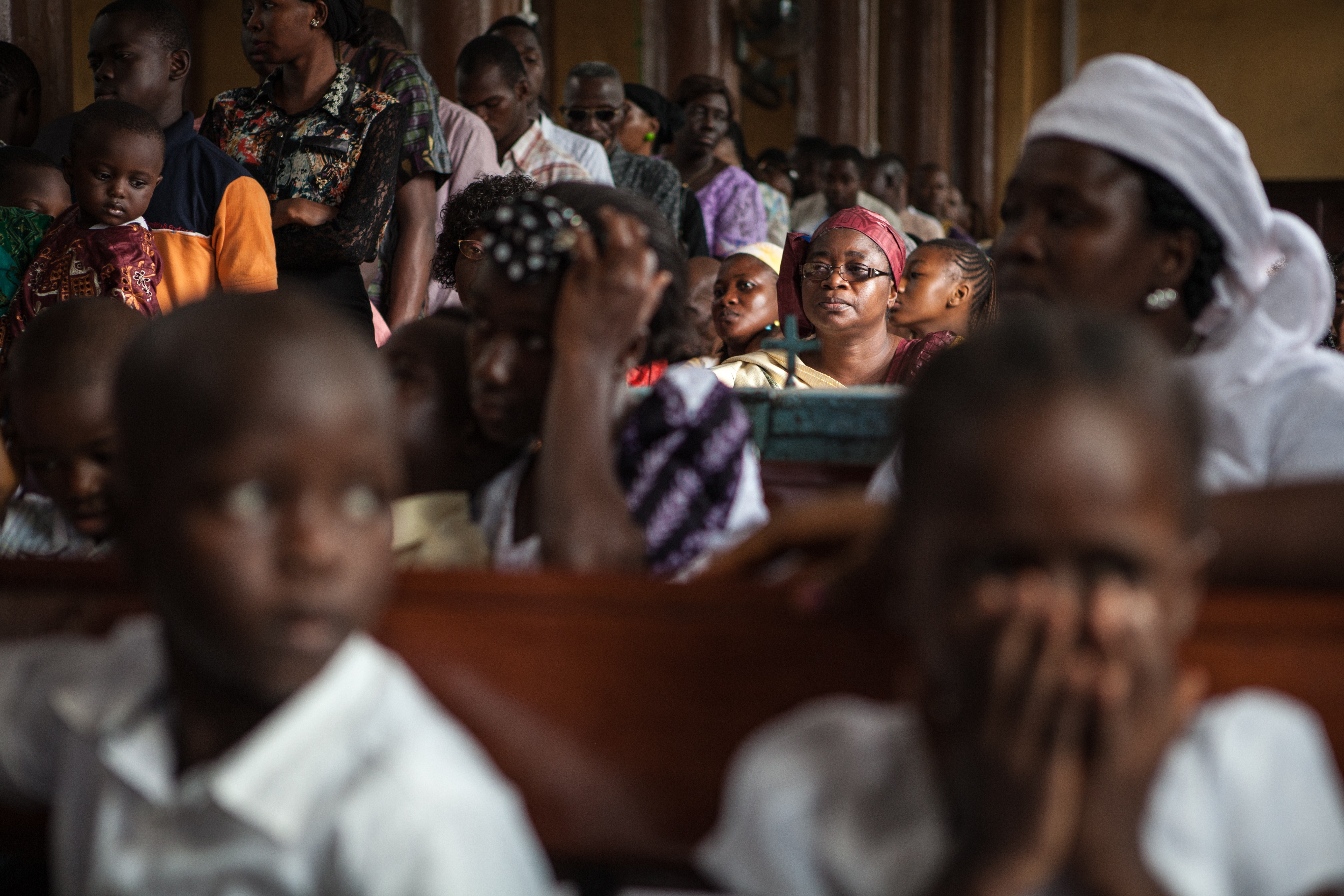 People pray for victims of the Ebola virus, on October 4, 2014 in Saint Anthony's Catholic church in the capital of Sierra Leone, Freetown.