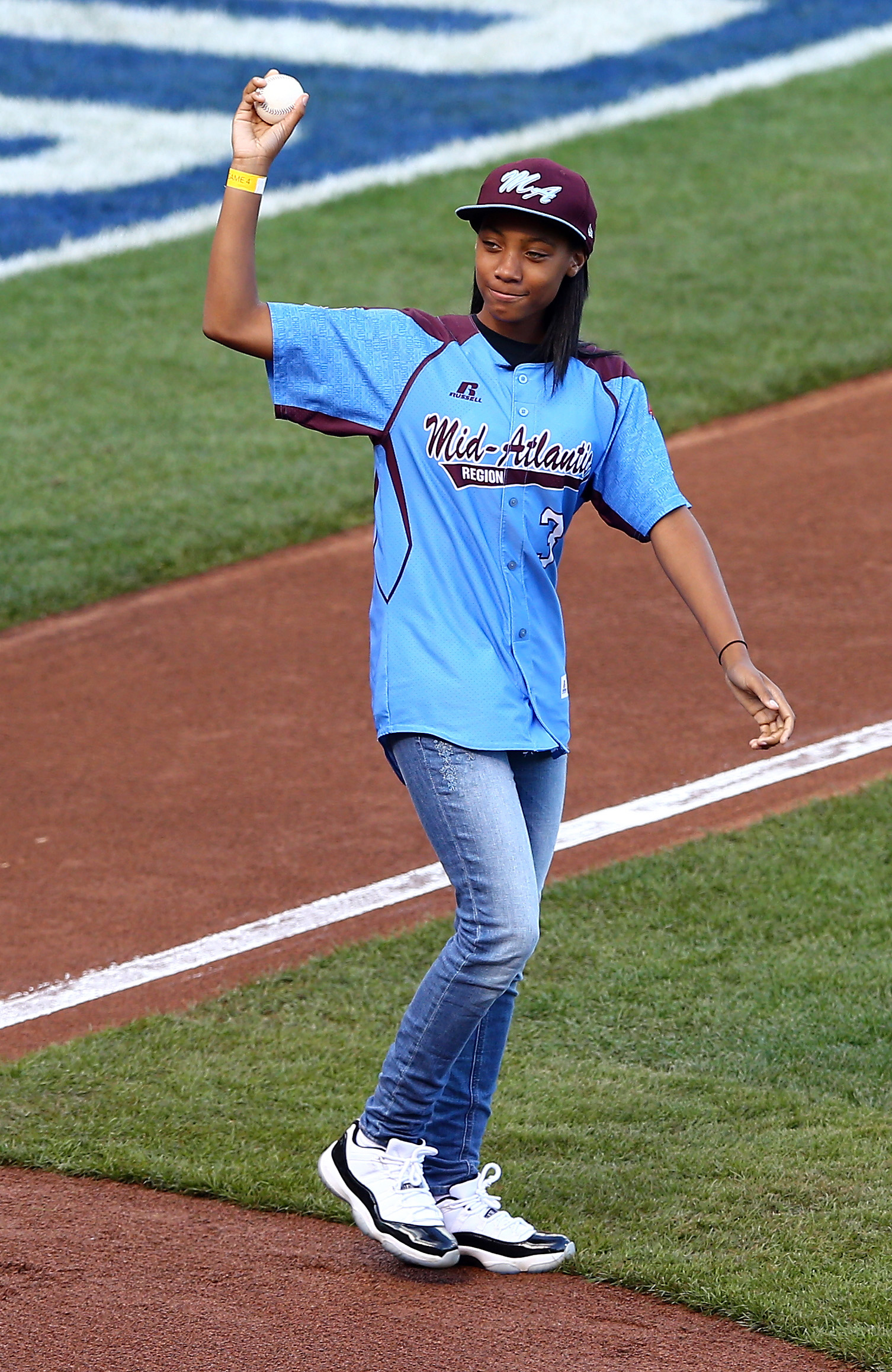 Little League Baseball pitcher Mo'ne Davis waves after she throws out the ceremonial first pitch before Game Four of the 2014 World Series at AT&T Park on October 25, 2014 in San Francisco, California.