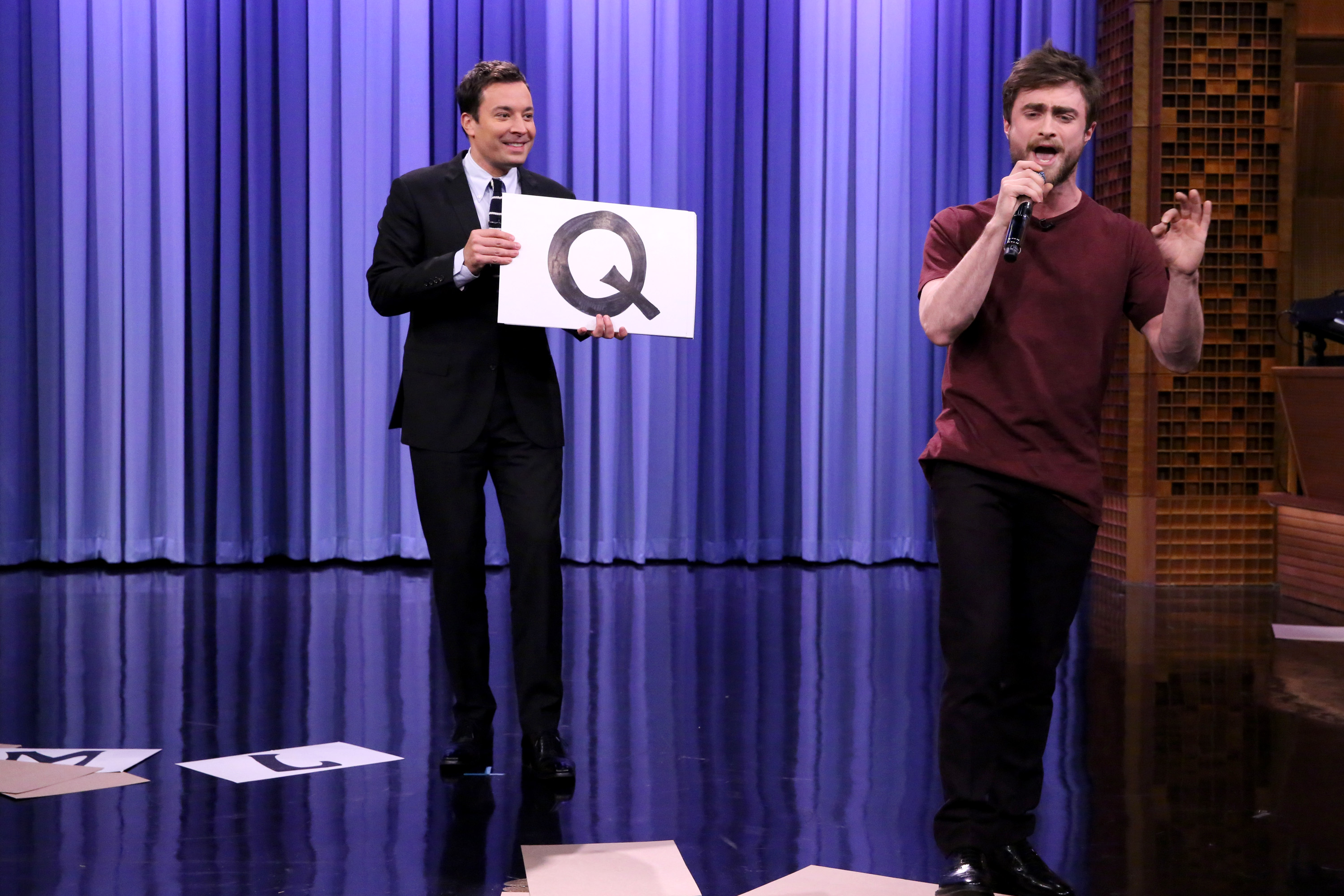 Host Jimmy Fallon watches as actor Daniel Radcliffe performs the  Alphabet Aerobics  rap by Blackalicious on October 28, 2014.