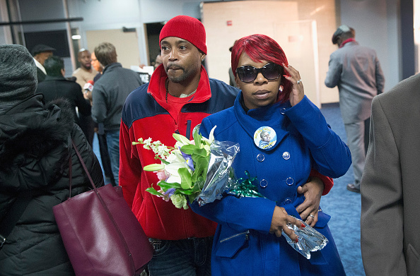 Michael Brown's mother Lesley McSpadden is greeted by her husband Louis Head after arriving at St. Louis International Airport on Nov. 14, 2014