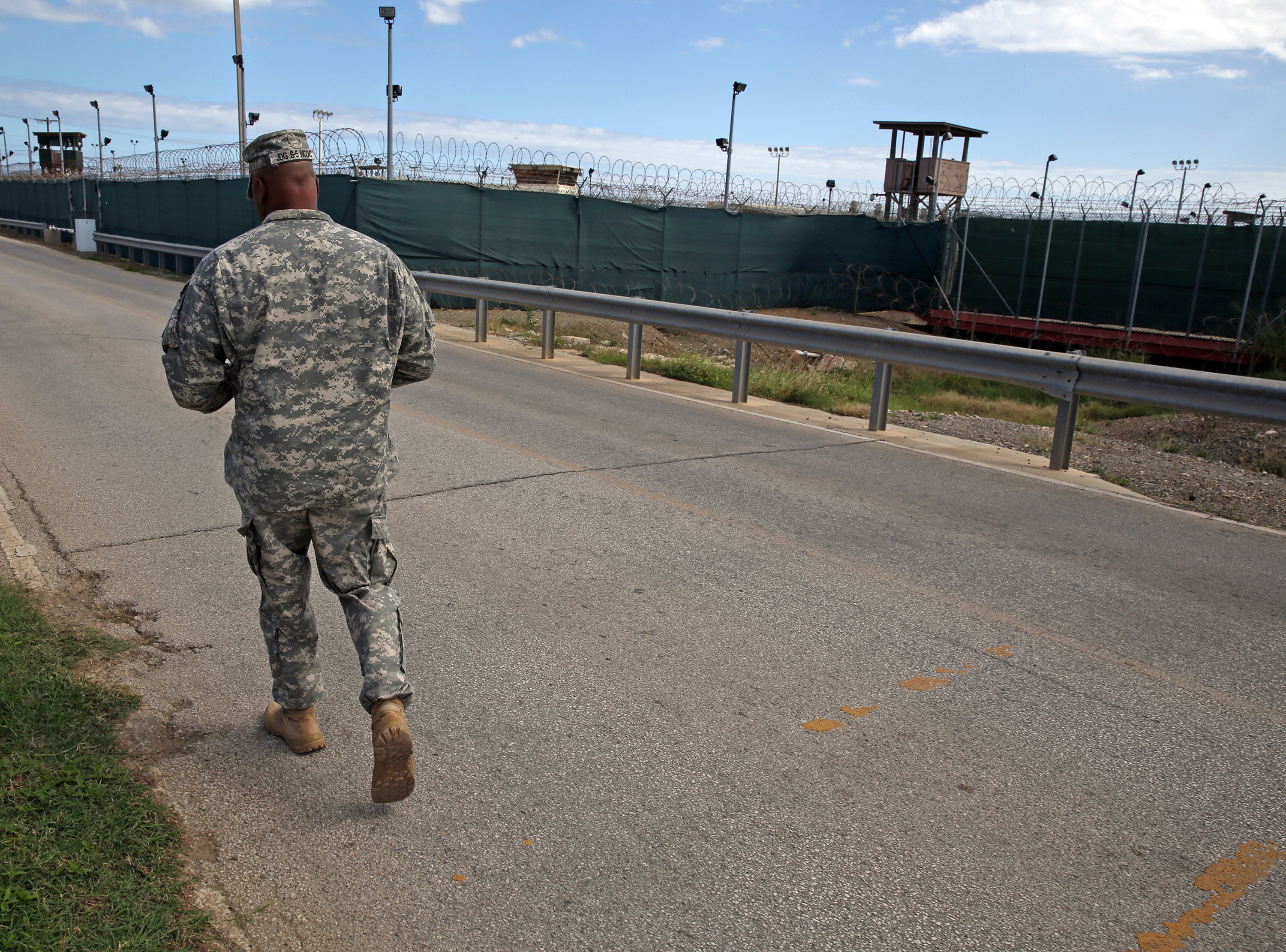 A soldier walks by Camp Delta, which no longer holds detainees, on Tuesday, Nov. 4, 2014 at the U.S. Navy base at Guantanamo Bay, Cuba in this photo approved for release by the U.S. military.