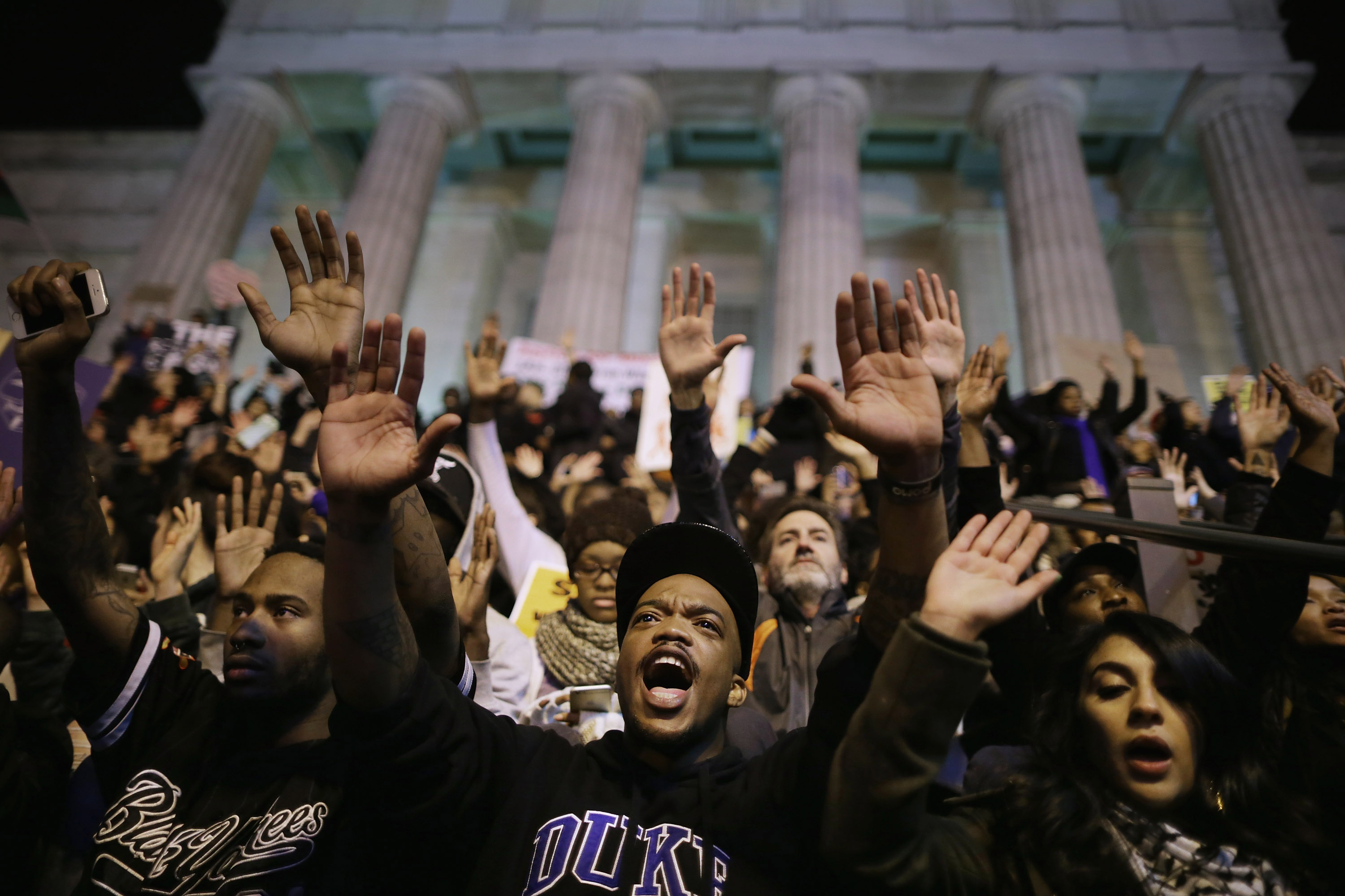 More than one thousand demonstrators chant  Hands up, don't shoot!  on the steps of the National Portrait Gallery in protest a day after the Ferguson grand jury decision to not indict officer Darren Wilson in the Michael Brown case November 25, 2014 in Washington, DC.