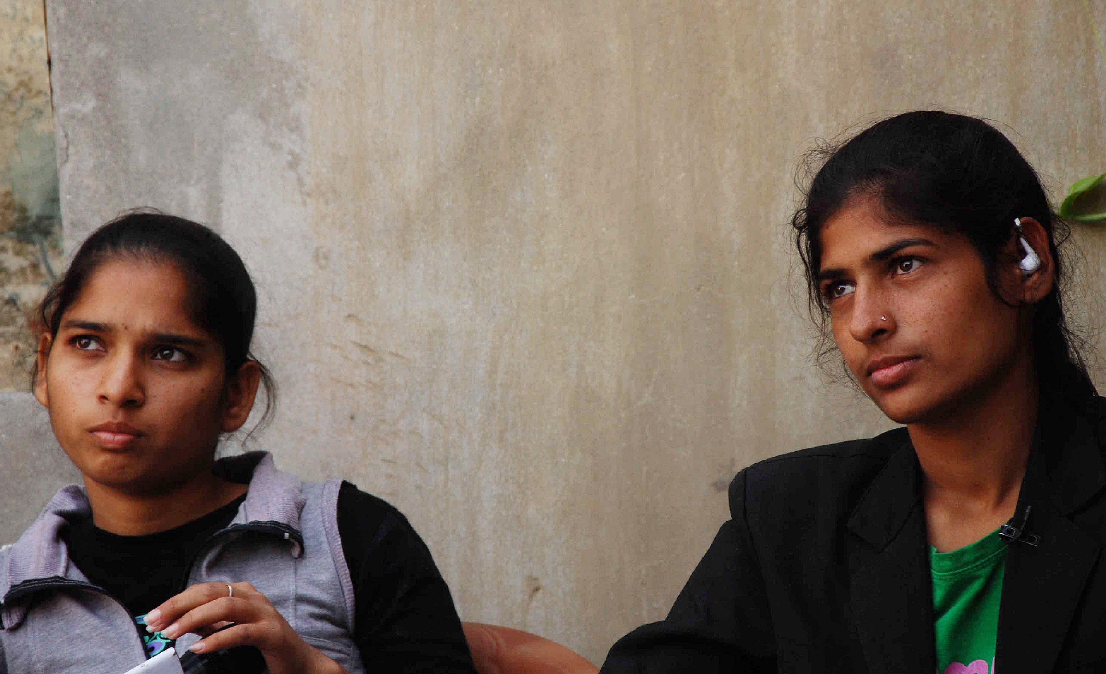 Indian sisters Pooja (L), 19, and Aarti, 22, are photographed at their home in the district of Sonepat on December 1, 2014. Two Indian sisters were showered with praise and cash on December 1 after a video of them thrashing three alleged molesters on a moving bus was widely replayed. Arti and Pooja Kumar, aged 22 and 19, were allegedly harassed by the men on a crowded bus last week while returning home in Rohtak, a district of largely rural Haryana state that borders New Delhi.