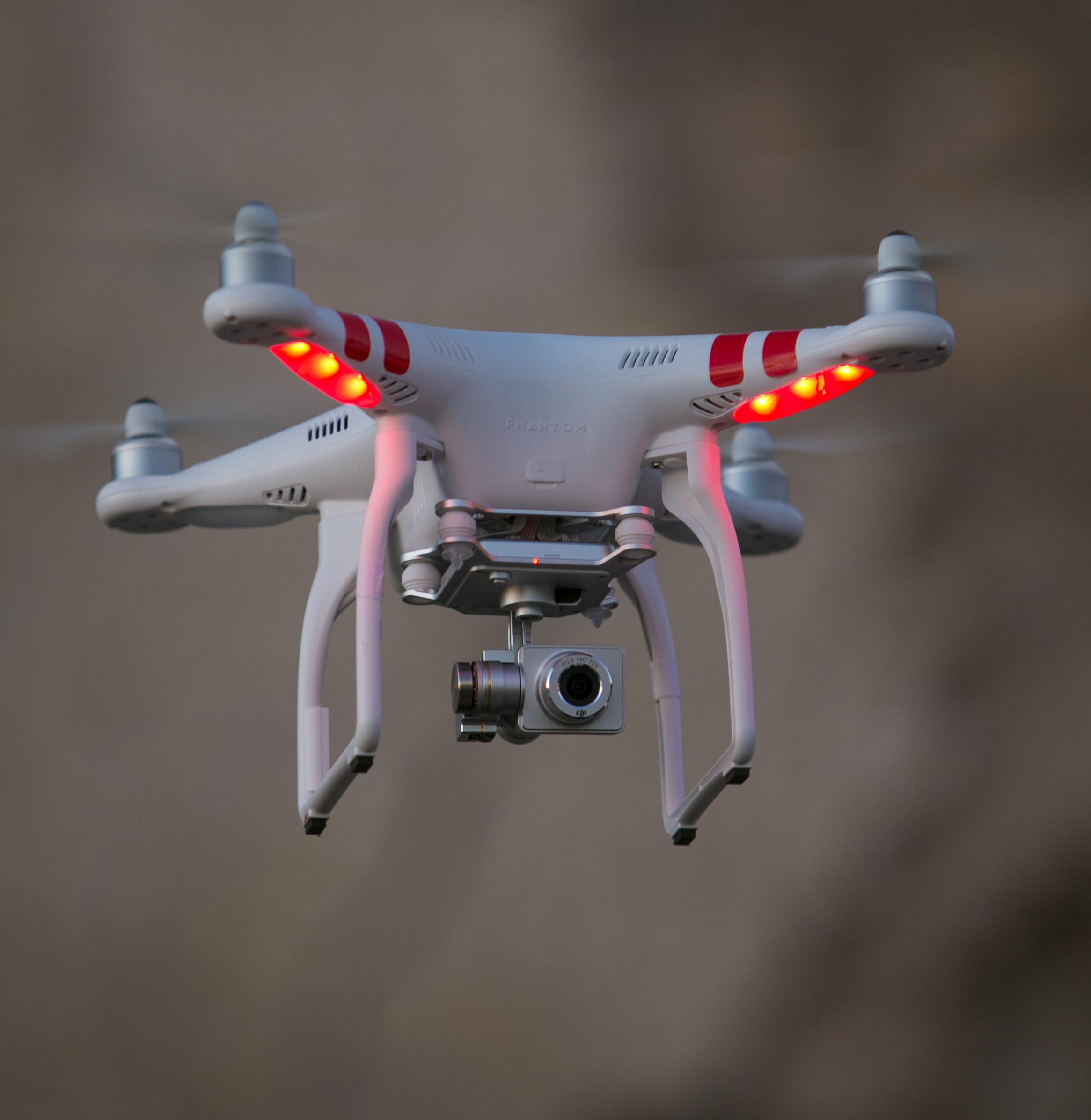 A Phantom drone buzzes above Gaviota State Beach at sunset on November 26, 2014, in Santa Barbara, California.