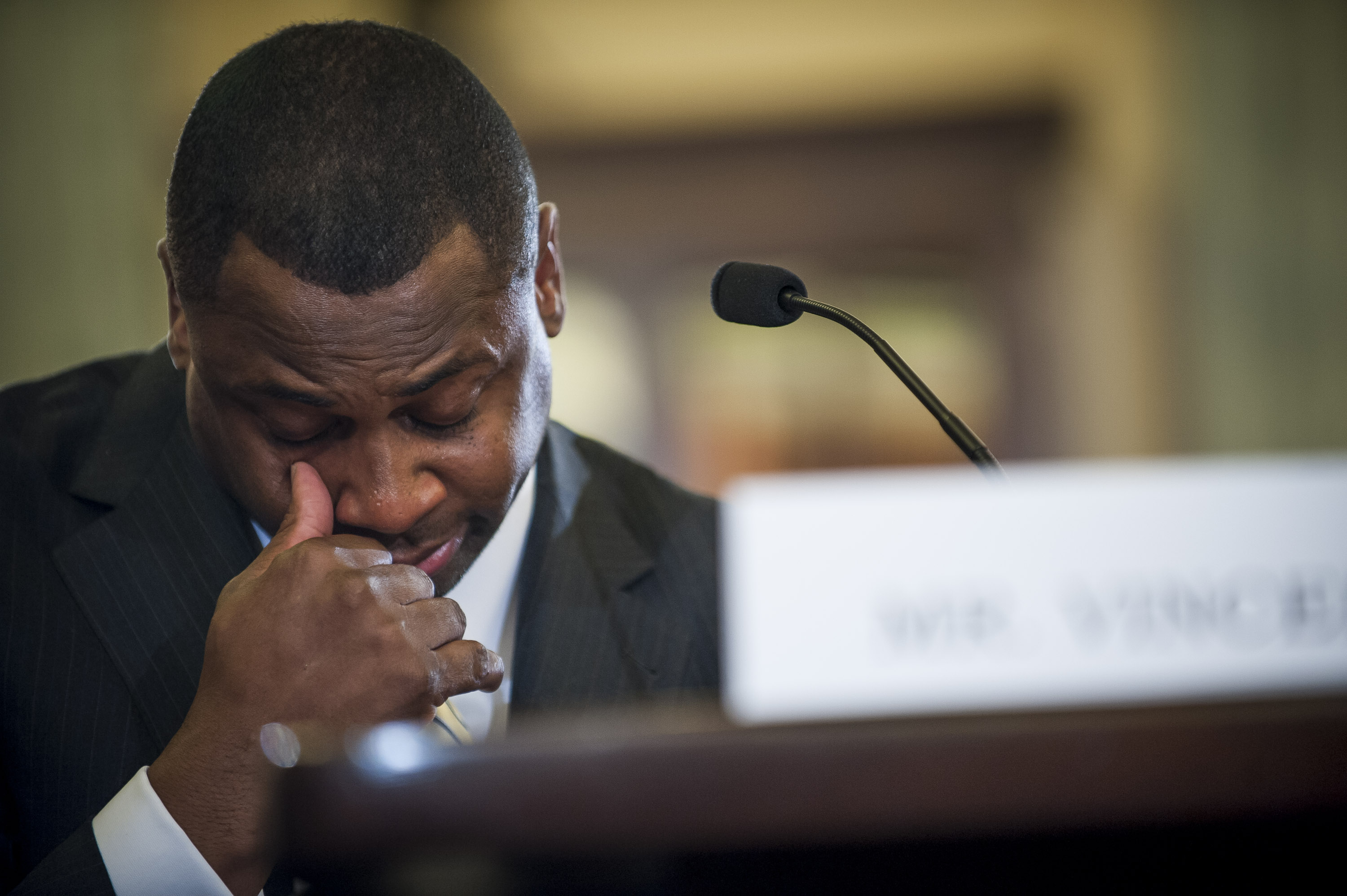 Troy Vincent, executive vice president of football operations for the National Football League becomes emotional while making his opening statement before the Senate Commerce, Science and Transportation Committee on Capitol Hill on December 2, 2014 in Washington, DC.