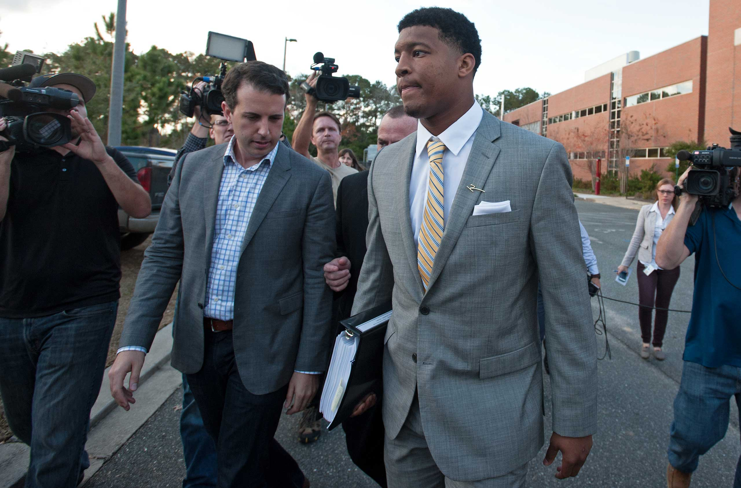 Florida State Seminoles quaterback Jameis Winston leaves his student conduct code hearing on Dec. 2, 2014 in Tallahassee, Fl.