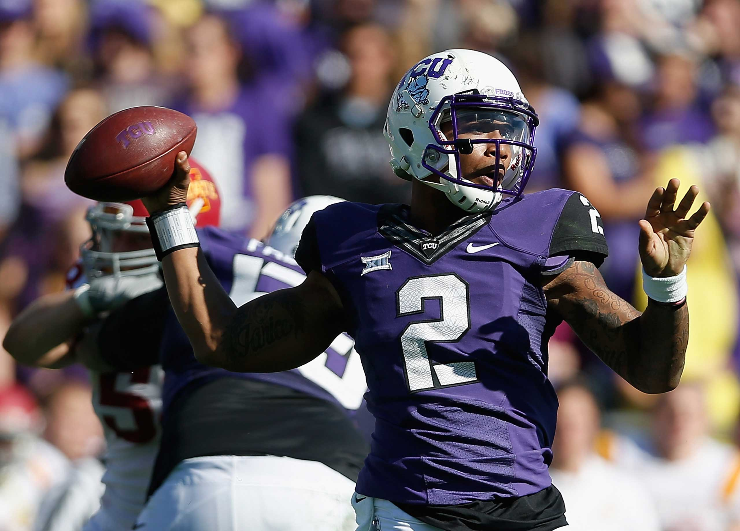 Texas Christian University Quarterback Trevone Boykin throws a pass during the thrid quarter of the Big 12 college football game against the Iowa State Cyclones at Amon G. Carter Stadium on Dec. 6, 2014 in Fort Worth, Texas.