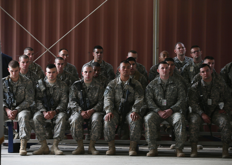 U.S. troops listen to Secretary of Defense Chuck Hagel speak during a visit to Baghdad International Airport on Dec. 9, 2014, in Baghdad