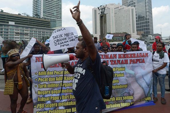 A Papuan activist delivers speech at the Hotel Indonesia roundabout in Jakarta on Dec. 10, 2014, during a protest against the killings of teenagers in the Papuan town of Enarotali two days earlier