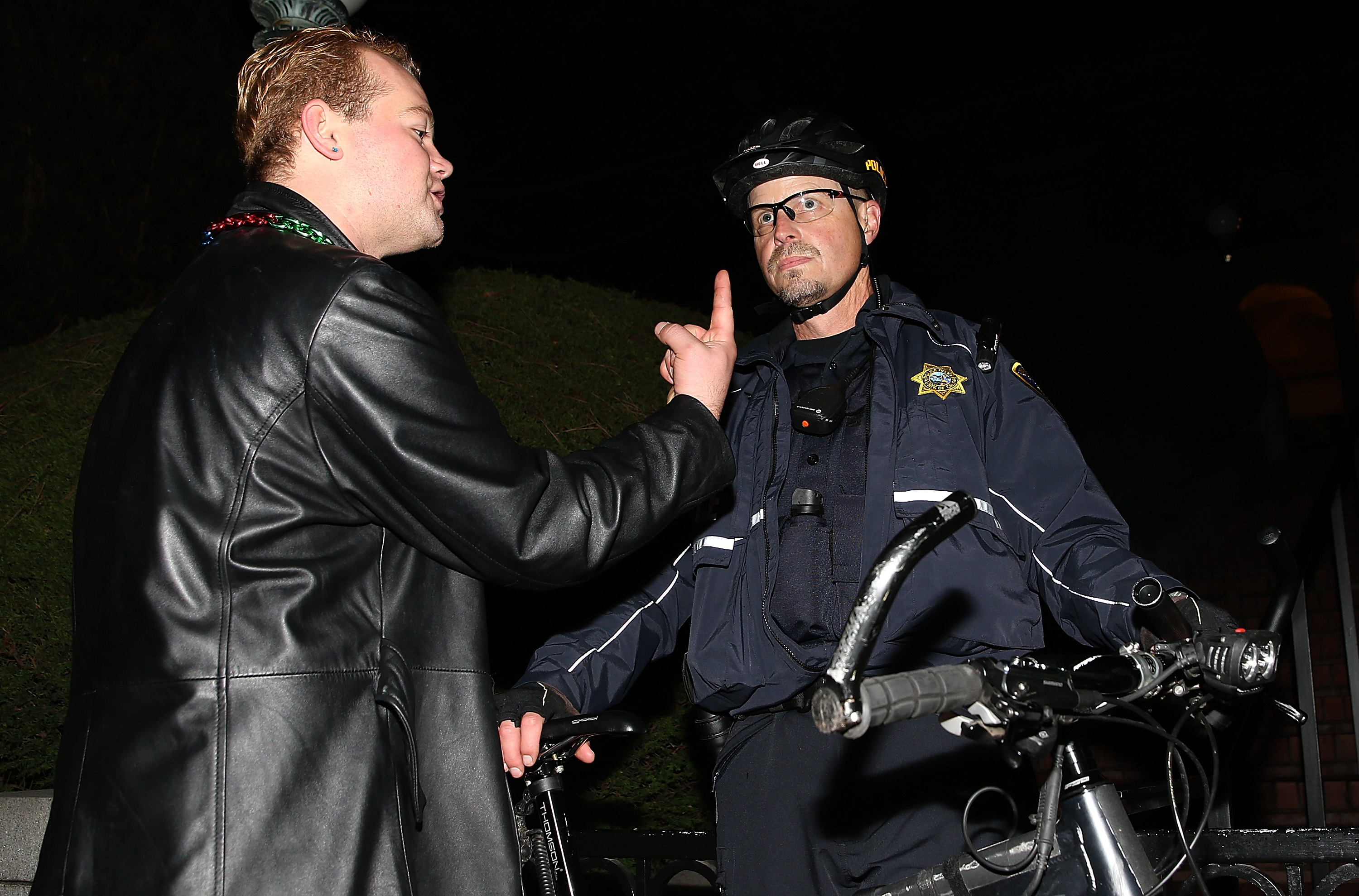 A protester confronts a UC Berkeley police officer during a demonstration over recent grand jury decisions in police-involved deaths on December 10, 2014 in Berkeley, California. Protesters have taken to the streets of Berkeley for a fifth straight night after a Staten Island, New York grand jury declined December 3 to indict New York City Police Officer Daniel Pantaleo in the chokehold death of Eric Garner.  (Photo by Justin Sullivan/Getty Images)