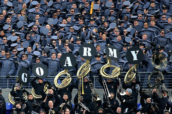 Army cadets cheer on their football team Saturday in their annual game against Navy.