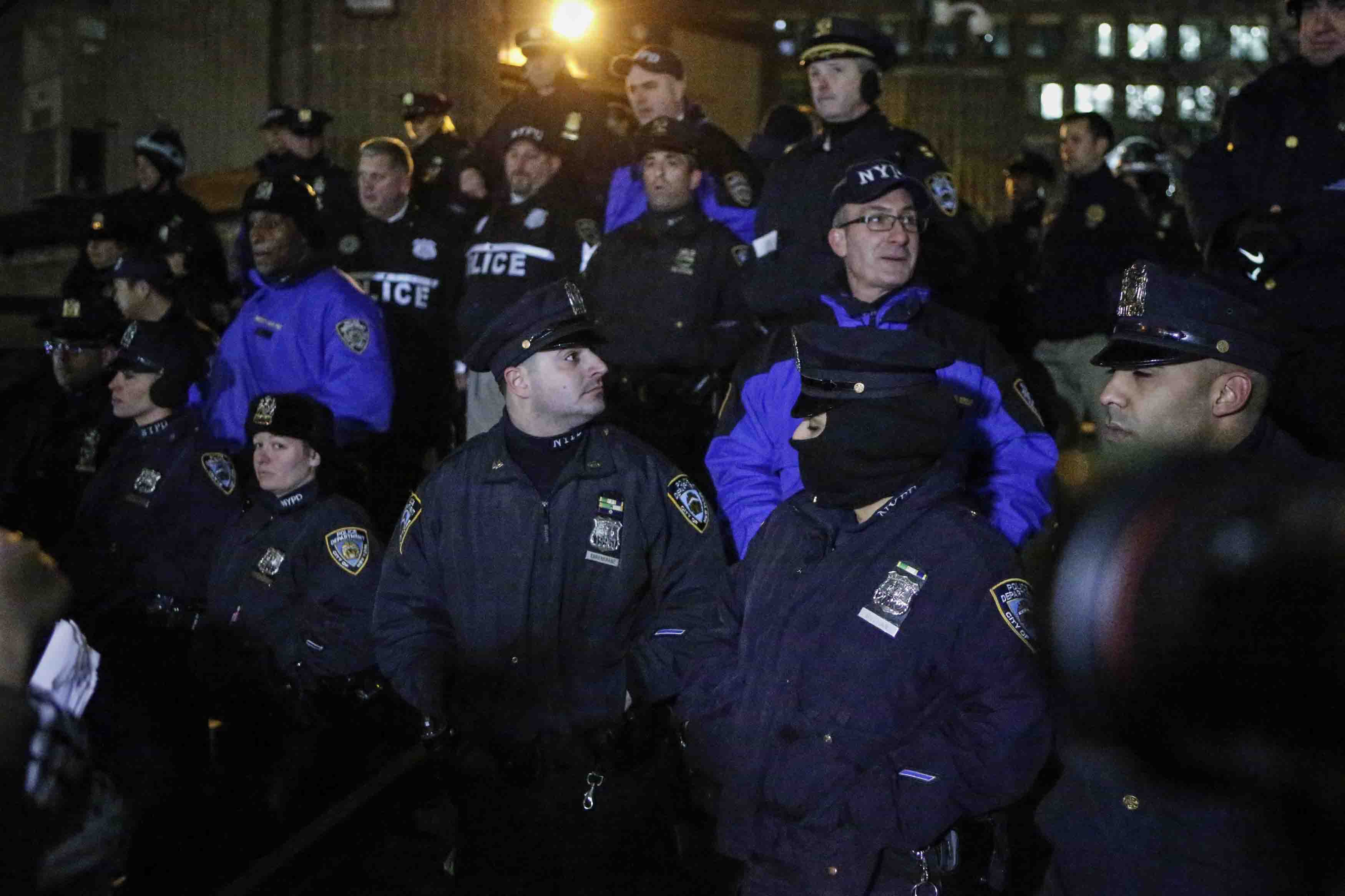 NYPD officers stand guard during the National March Against Police Violence, which was organized by National Action Network, at One Police Plaza on December 13, 2014 in New York City.