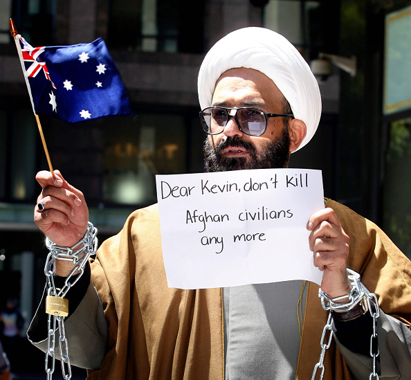 Iranian-born Sheik Haron, who is named in court papers as Man Haron Monis, chained to a railing outside the Downing Centre Court in Sydney in an antiwar protest on Nov. 10, 2009