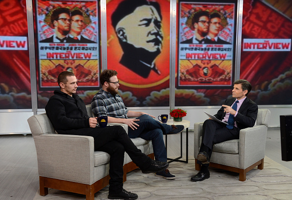 Stars of 'The Interview' James Franco and Seth Rogen, left and center, appear on 'Good Morning America' on Dec. 15, 2014