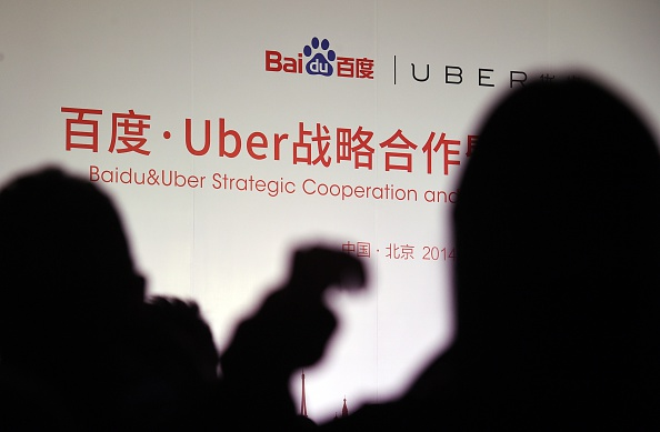 Journalists wait for the start of a signing ceremony between Uber and Baidu at the Baidu headquarters in Beijing on Dec. 17, 2014