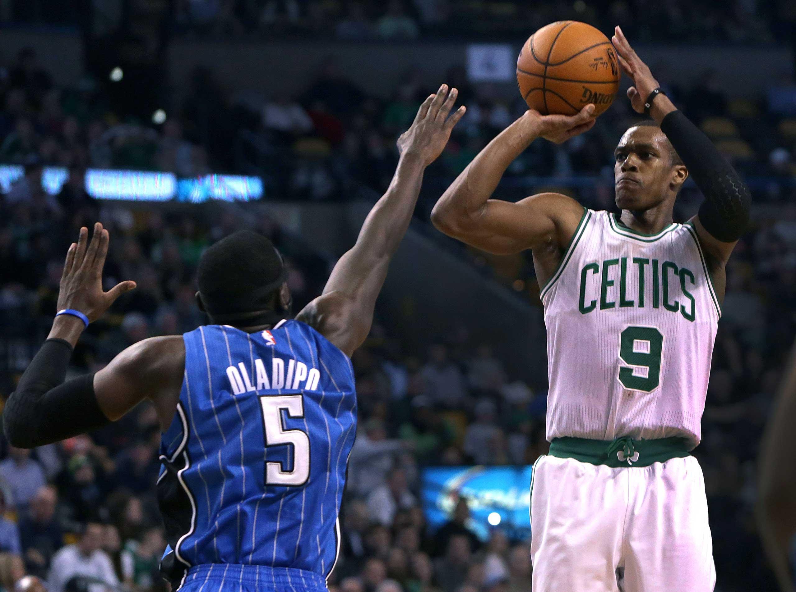 Boston Celtics guard Rajon Rondo (#9) hits a short jumper over Orlando Magic guard Victor Oladipo (#5) in the second quarter on Dec. 17, 2014.