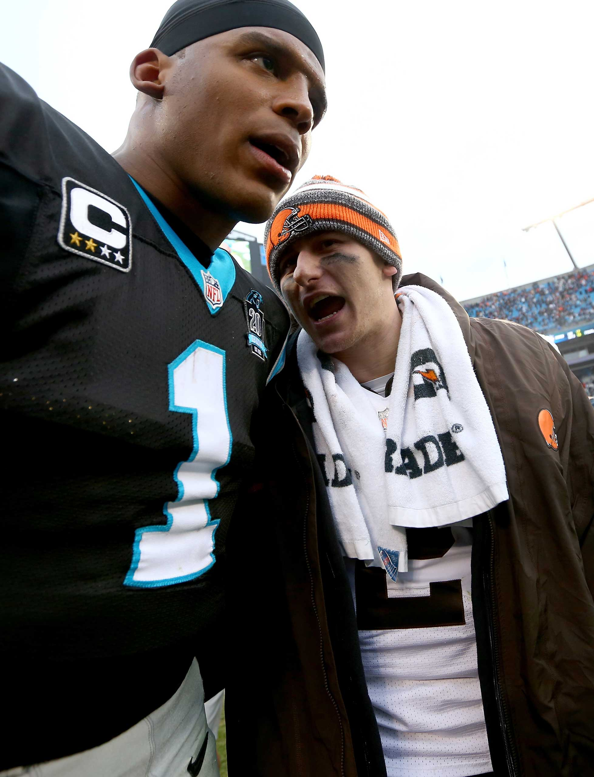 Cam Newton #1 of the Carolina Panthers and Johnny Manziel #2 of the Cleveland Browns exchange words after their game at Bank of America Stadium on Dec. 21, 2014 in Charlotte, North Carolina.
