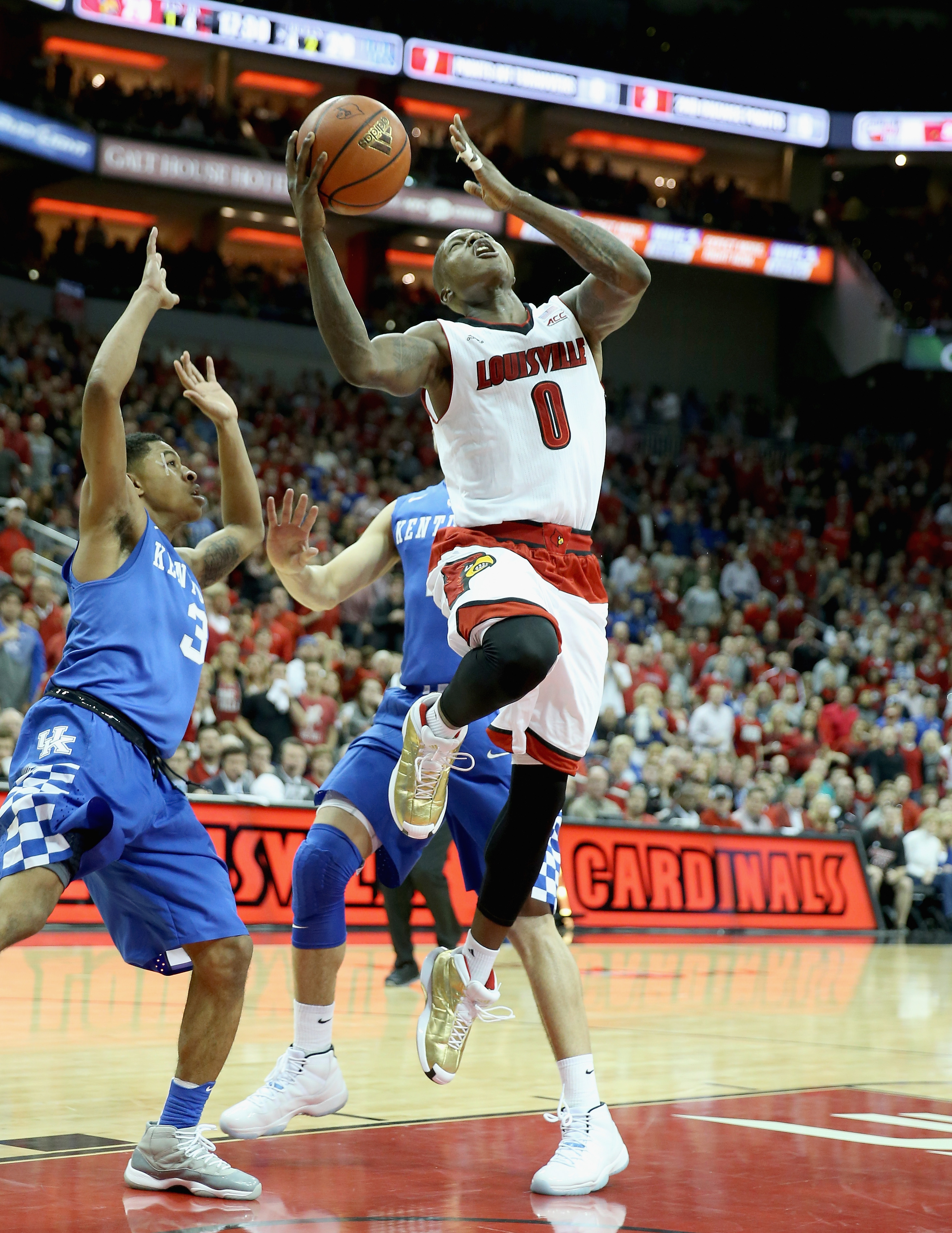 Terry Rozier #0 of the Louisville Cardinals shoots the ball during the game against the  Kentucky Wildcats at KFC YUM! Center on December 27, 2014 in Louisville, Kentucky.