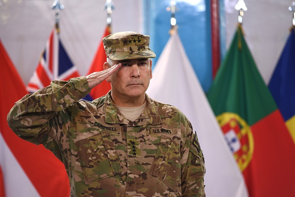U.S. Army General John Campbell salutes during a ceremony marking the end of the allied combat mission in Afghanistan at his headquarters in Kabul, Dec. 28, 2014.