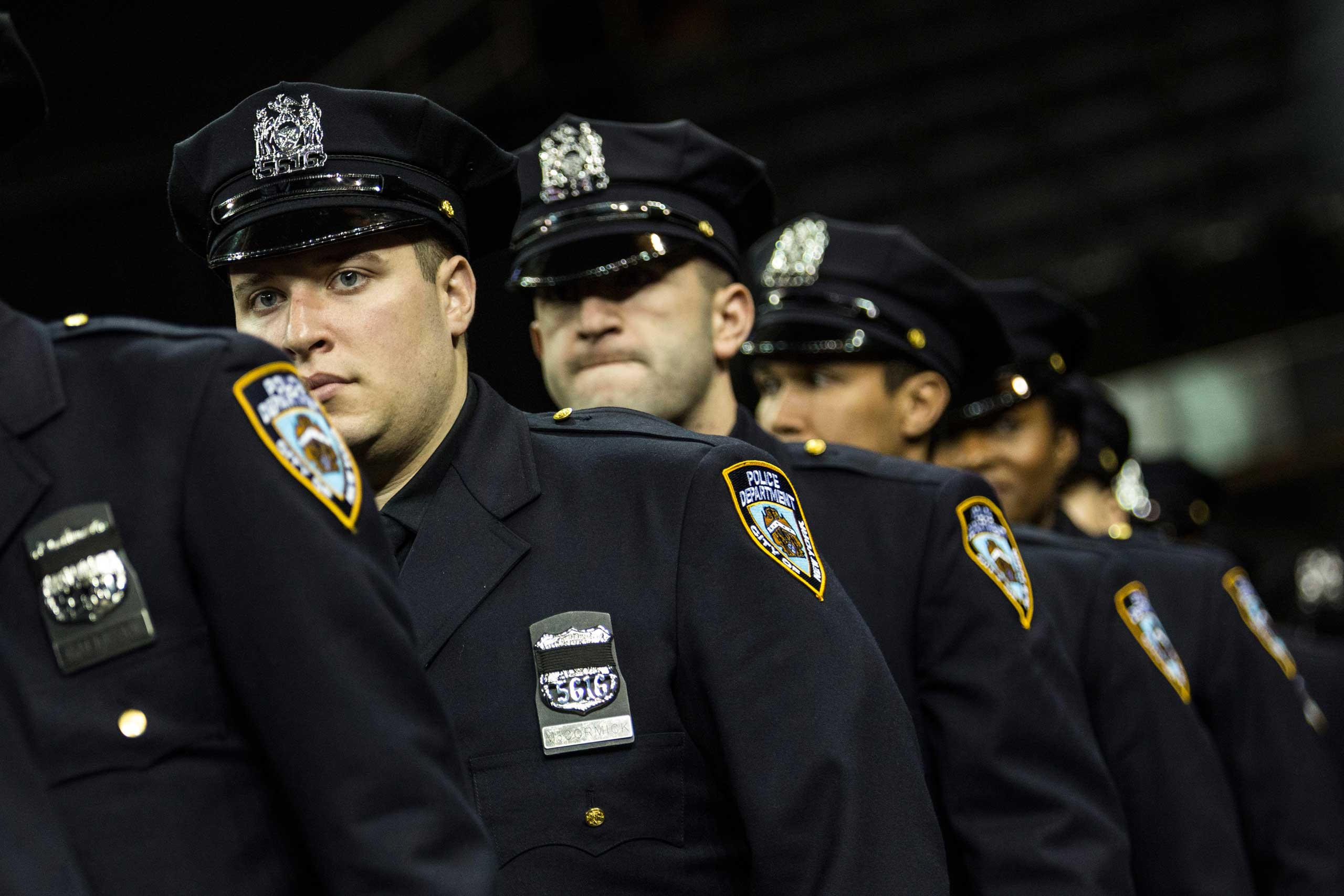 Police officers attend their New York Police Department graduation ceremony at Madison Square Garden on Dec. 29, 2014 in New York City.
