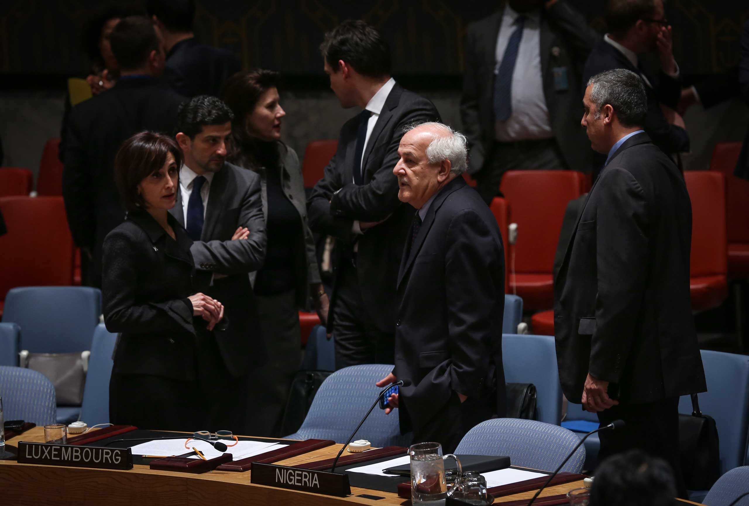 Riyad Mansour, second right, Permanent Observer of Palestine to the United Nations, is seen during the United Nations (UN) Security Council meeting in New York on Dec. 30, 2014.