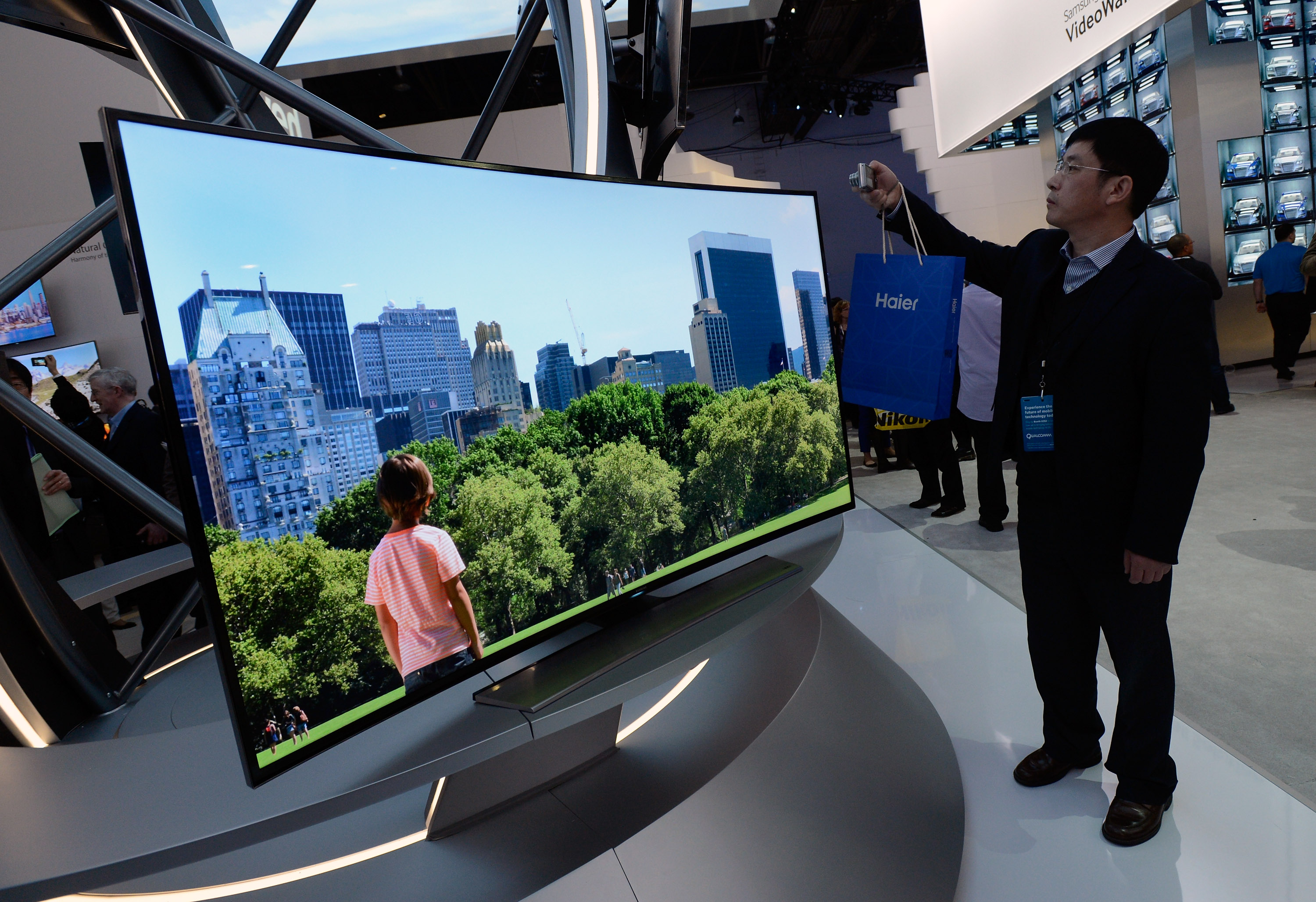 A Samsung curved OLED television is on display at the Samsung booth at the 2014 International CES at the Las Vegas Convention Center on January 7, 2014 in Las Vegas, Nevada.
