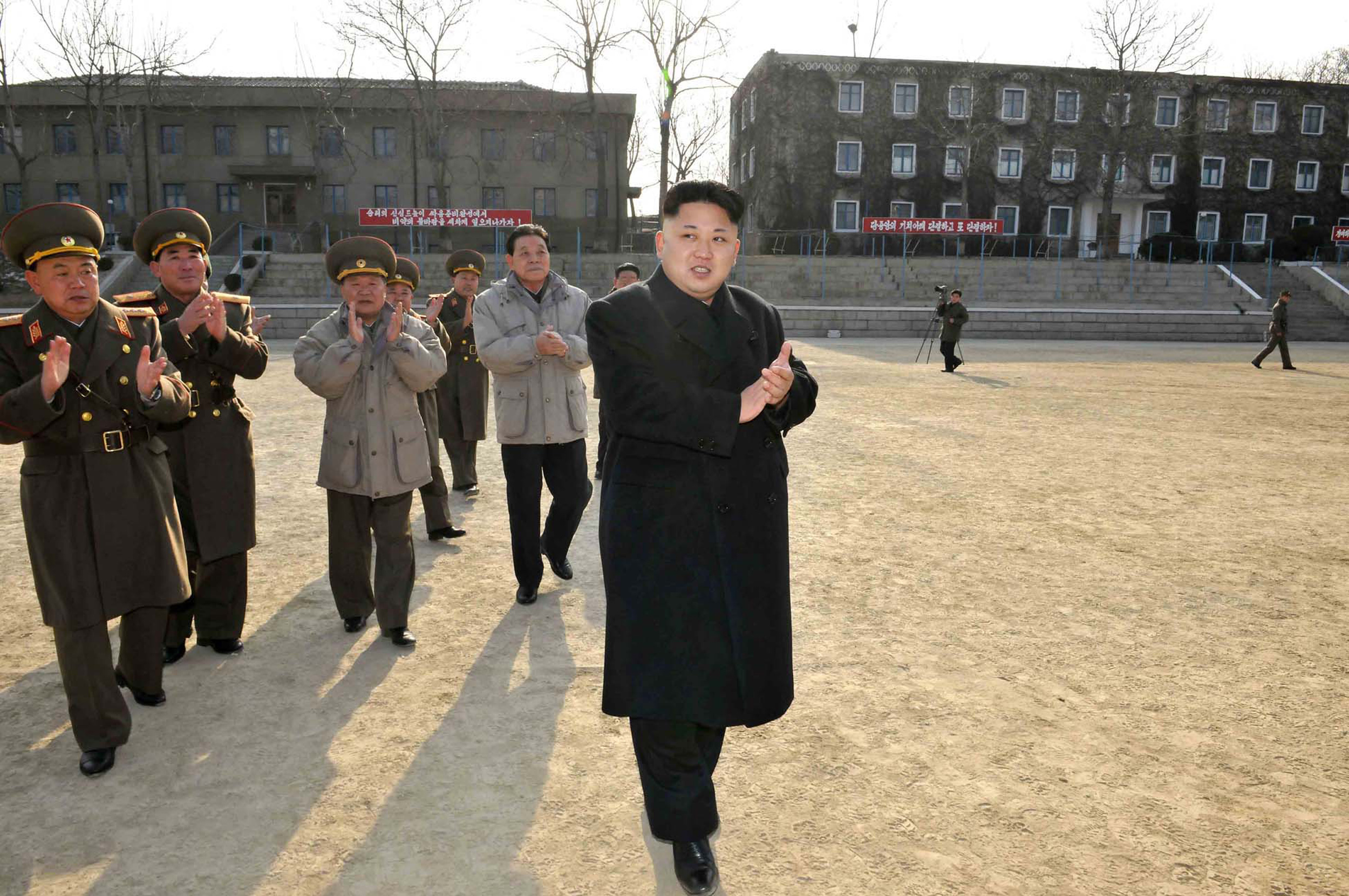 This undated picture released from North Korea's official Korean Central News Agency (KCNA) on January 12, 2014 shows North Korean leader Kim Jong-Un inspecting the command of Korean People's Army  Unit 534.