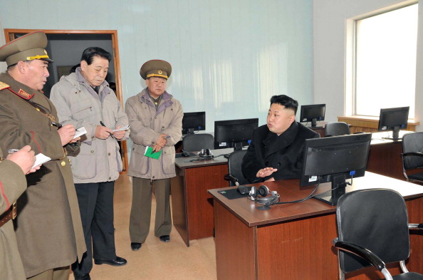 North Korea leader Kim Jong un, seated at right, visits a command center of the North Korean army in this undated photograph provided by North Korea.