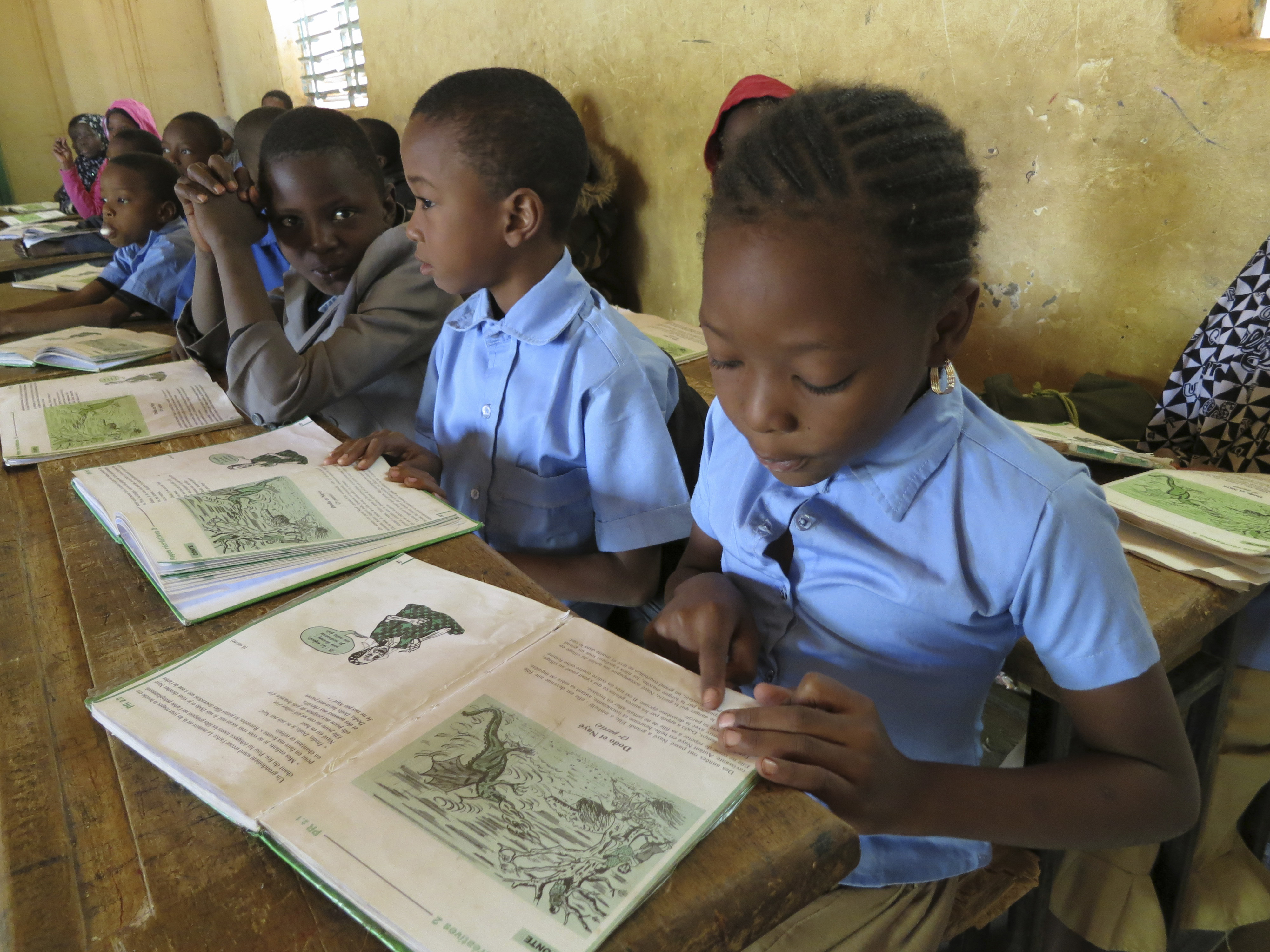 Students reading in school books at a Nigerian school on December 09, 2013, in Niamey, Niger.