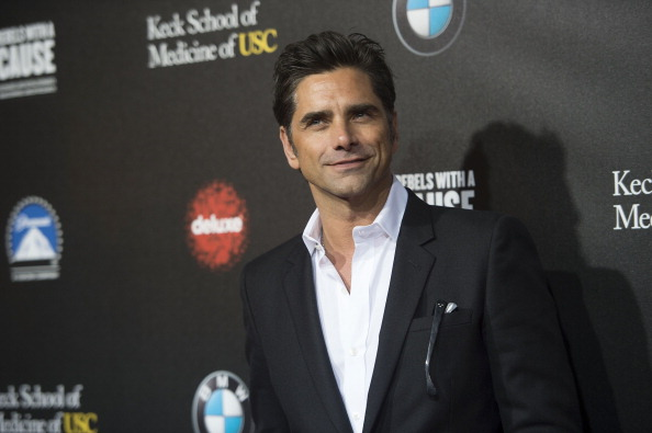John Stamos attends the Rebel With a Cause Gala hosted at the Paramount Studios in Hollywood on March 20, 2014