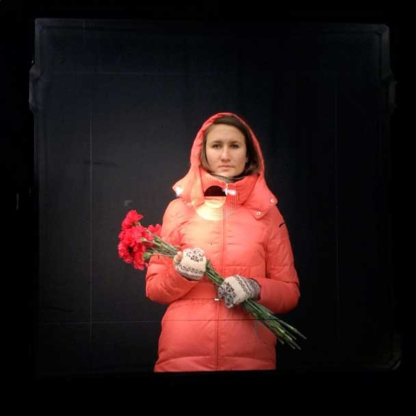This is the first quiet day for Kiev's residents to come here. So we came to put flowers and pay respect to the people who died.  —Olga, 26 years old, from Kiev  Today there is mourning  From my dispatch with viewfinder portraits from Maidan, Kiev on Foreign Policy.                        http://www.foreignpolicy.com/articles/2014/02/24/today_there_is_mourning_kiev_protester_maidan                                              Images made on an iPhone through my Bronica viewfinder.                       #kiev #ukraine #filmisnotdead #fujifilm #bronica #6x6 #portrait #photography #photojournalism @viiphoto