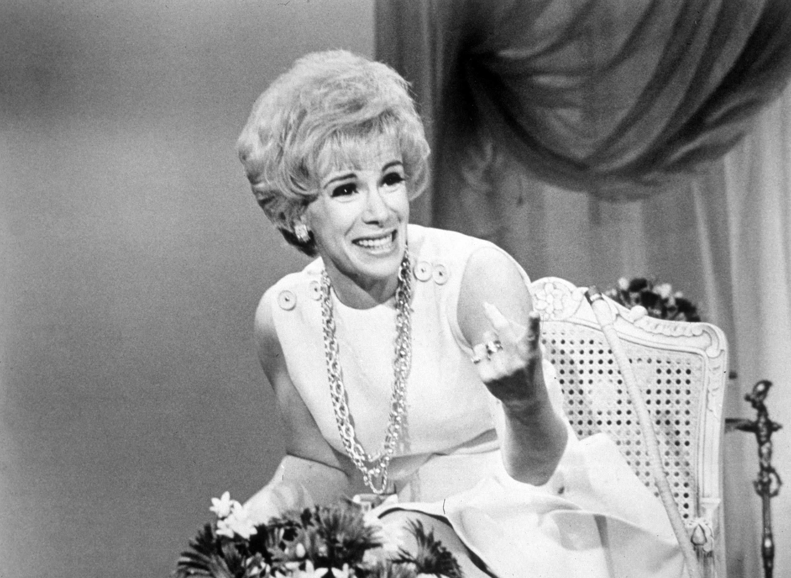 American comedian Joan Rivers laughs while hosting the television program 'That Show,' 1969.