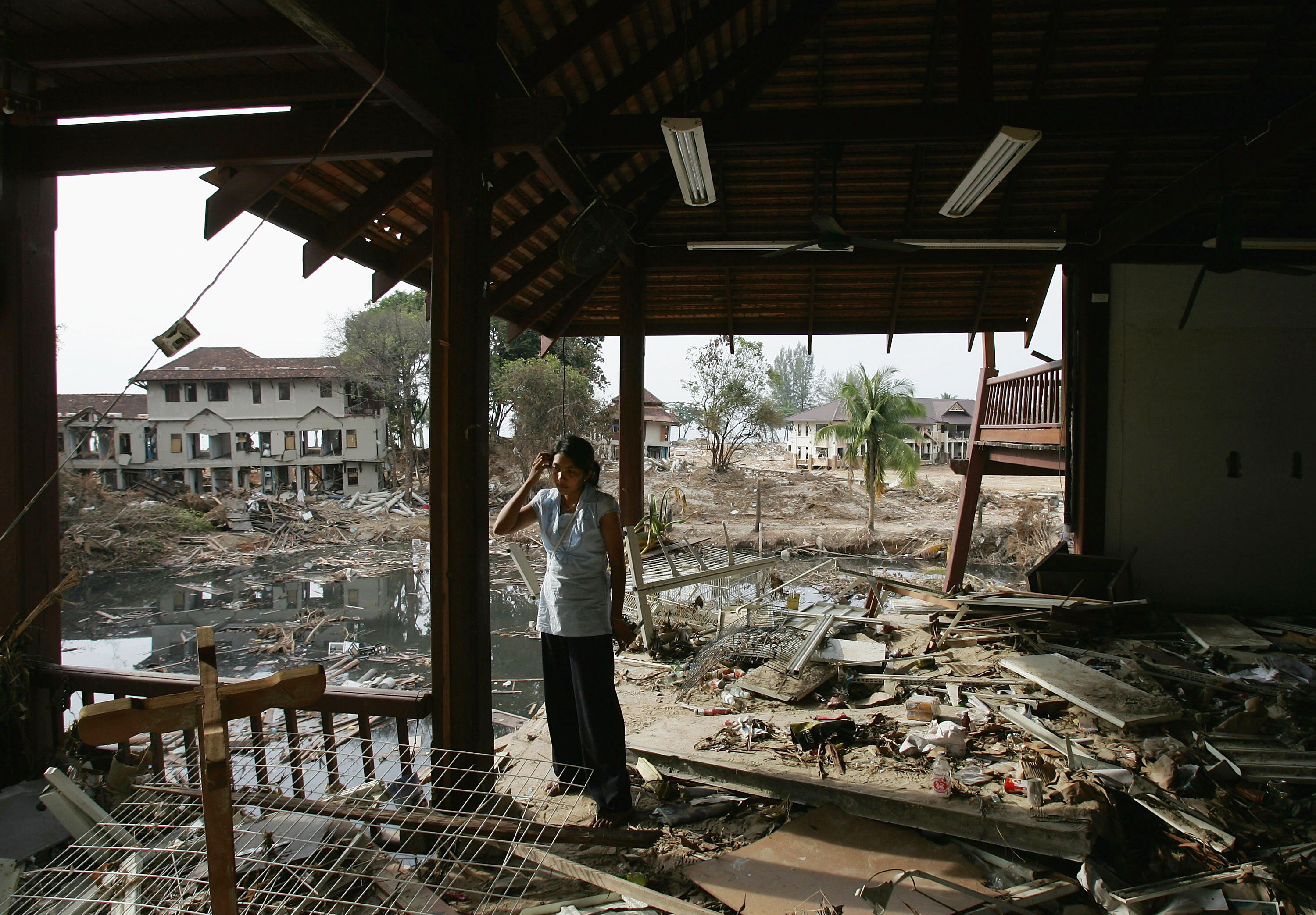 Tsunami survivor Paphun Somsri of Thailand returns to the destroyed seaside hotel where she used to work, in Khao Lak, Thailand on Jan. 7, 2005