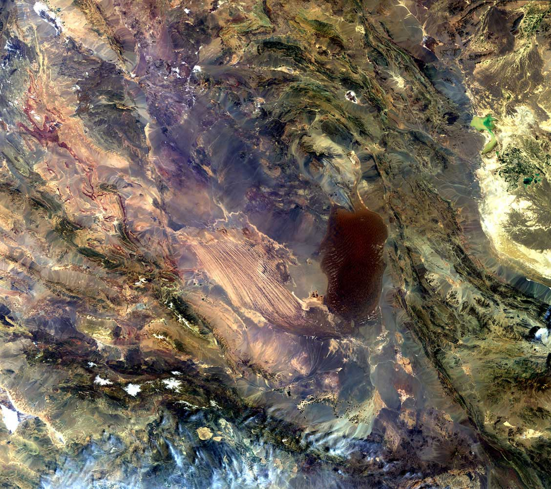 "The Dasht-e Lut salt desert in southeast Iran, as seen from space. It's often called the ""hottest place on Earth,"" and with good reason. The highest land surface temperature ever recorded was in 2005, when NASA's Aqua satellite recorded a reading of  160ºF."