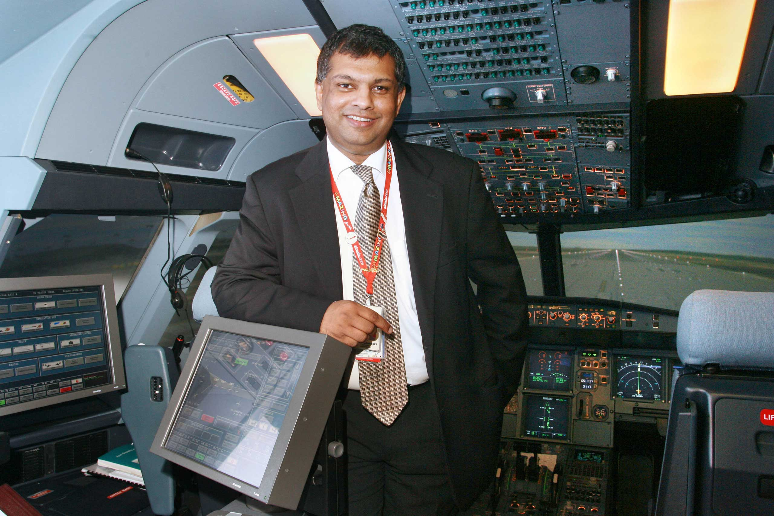 Fernandes poses for a photo in a Boeing Simulator after the Air Asia annual general meeting held at Kuala Lumpur, Dec. 28, 2006.