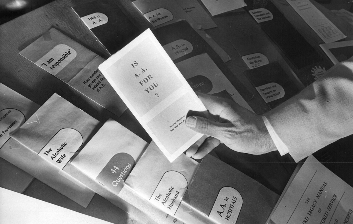 An Alcoholics Anonymous Member points to available literature, in 1967