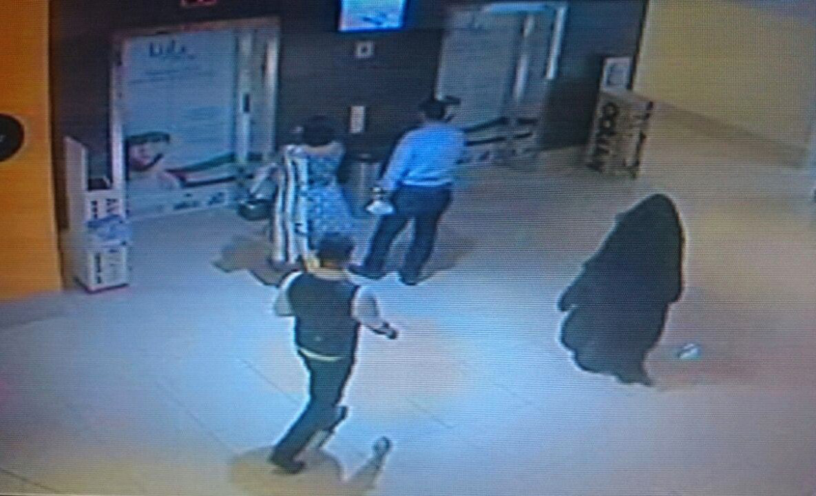 A CCTV image shows a fully veiled woman walking in a shopping mall in the Emirati capital, Abu Dhabi. The woman is a suspect in the killing of an American teacher stabbed in the Boutik Mall's toilet.