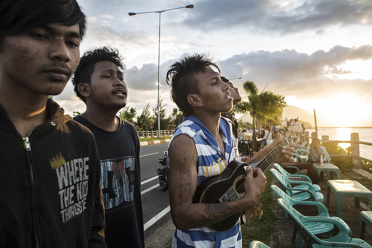 Romy Syahputera plays the ukulele and sings together with his punk-rock friends at the beach of Ulee Lheue in Aceh province, Indonesia, on Nov. 18, 2014.