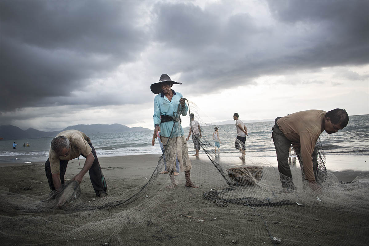 Fishermen at work on a beach outside Banda Aceh, Indonesia, on Nov. 17, 2014