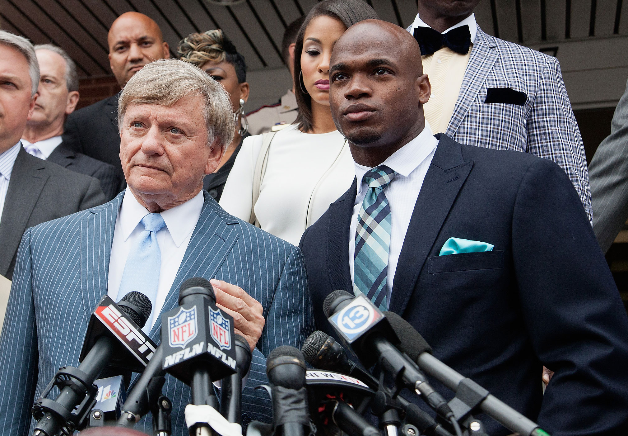 Defense attorney Rusty Hardin, left, and NFL running back Adrian Peterson of the Minnesota Vikings address the media on November 4, 2014 in Conroe, Texas.