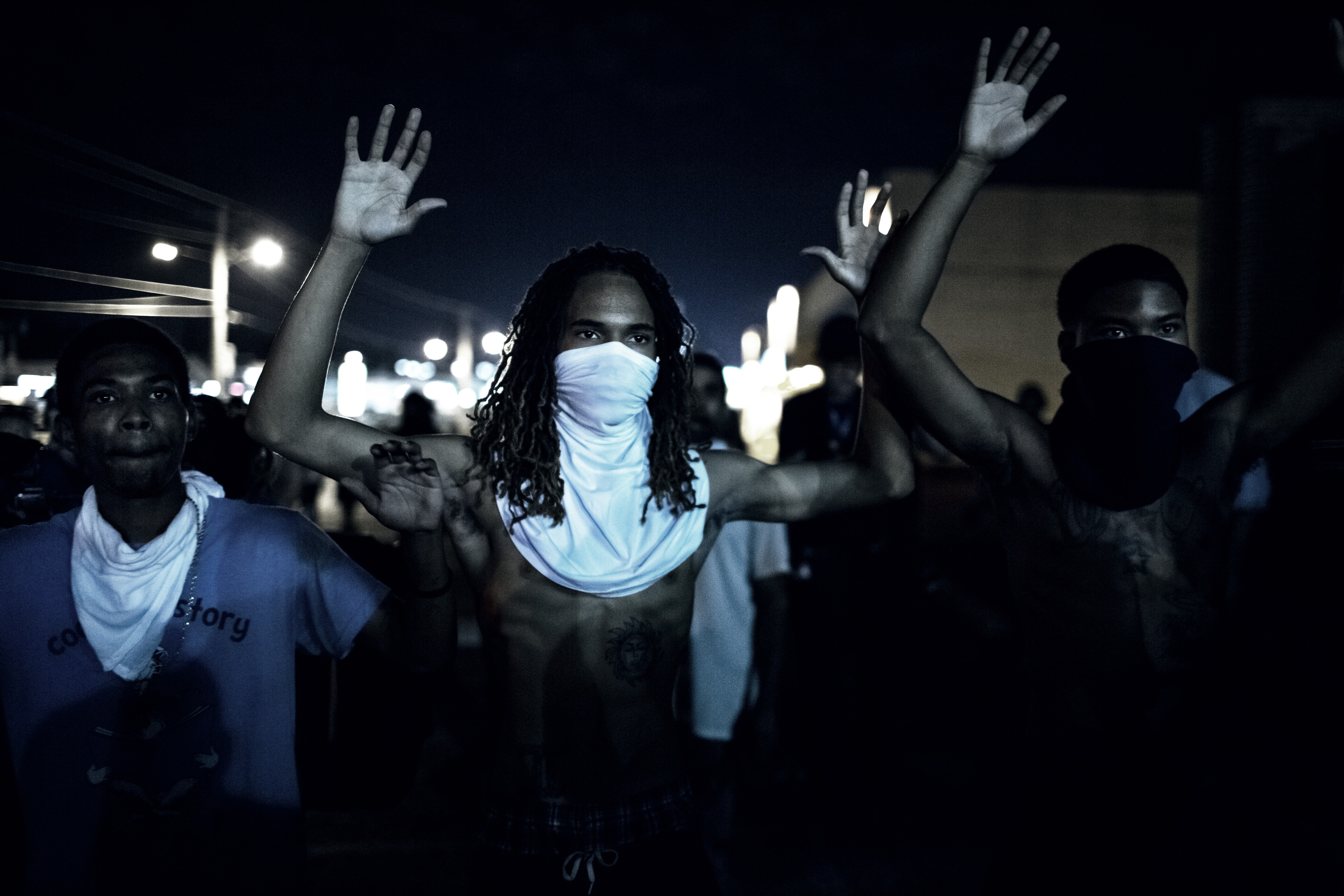 Demonstraters protest the shooting death of unarmed black teenager Michael Brown by police, during clashes with police that erupted following a mostly peacful protest early on Aug 20, 2014 in Furguson, Mo.